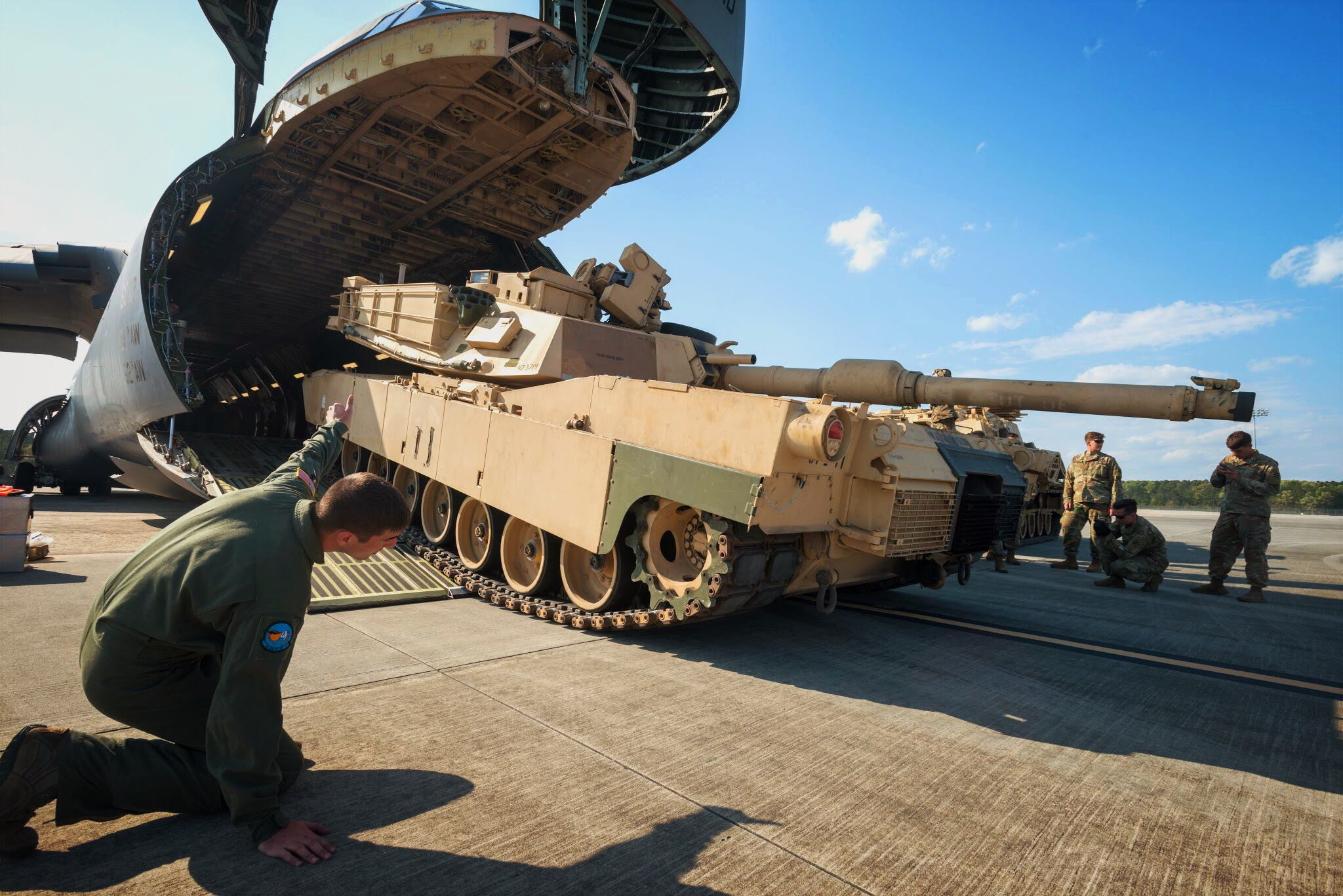 """Soldiers of the 2nd Battalion, 7th Infantry Regiment, 1st Armored Brigade Combat Team, 3rd Infantry Division load a M1A1 Abrams tank onto a C5 """"Super Galaxy"""" at Fort Stewart Hunter Army Airfield, Ga. The battalion is rehearsing air load operations for the division's Immediate Ready Company, responsible to maintaining readiness in support of the Global Response Force mission to deploy within 18 hours of notification. (US Army Photo)"""