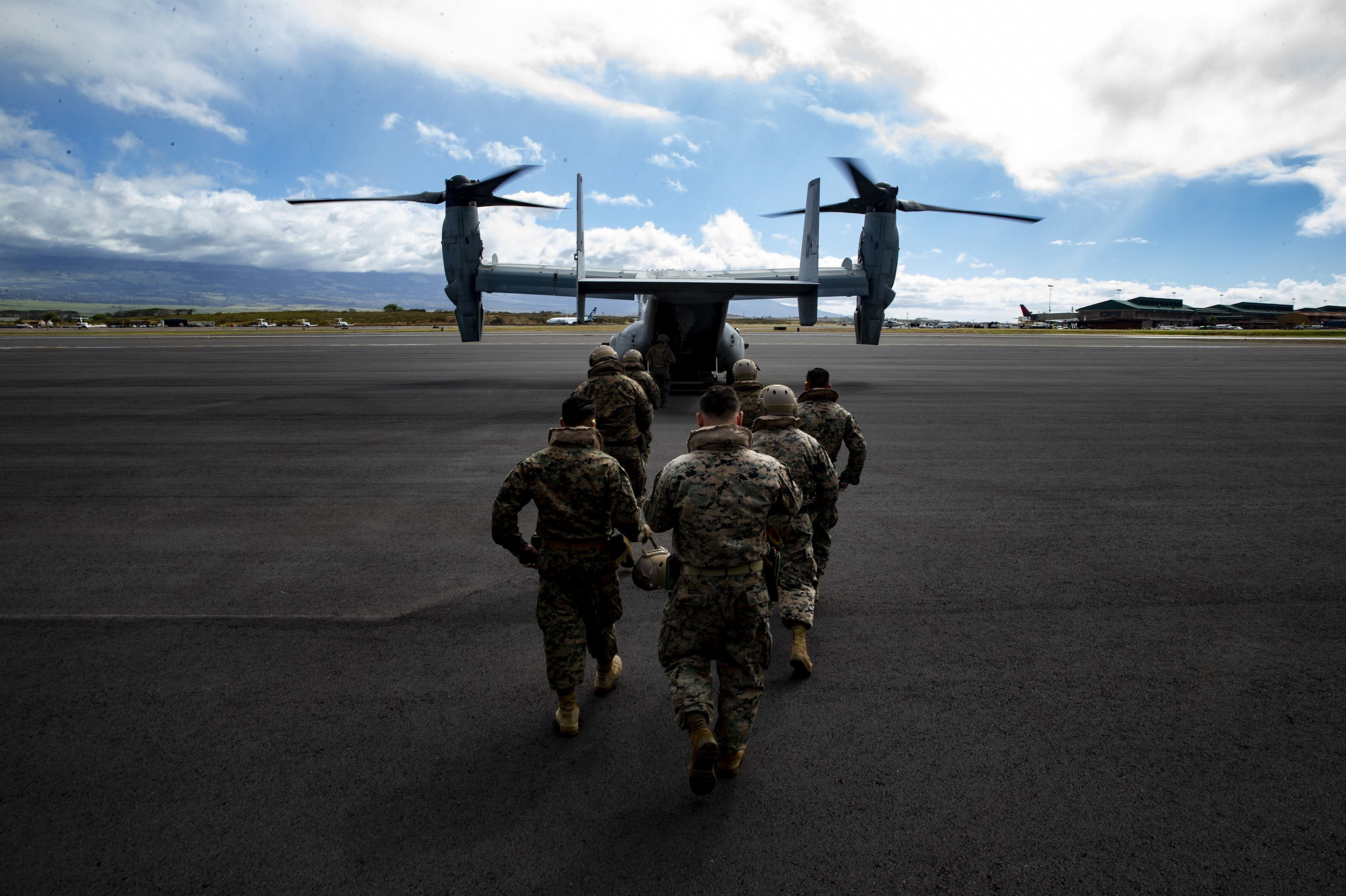 Reconnaissance Marines return to an MV-22B Osprey after transporting Marine Toys for Tots Donations from Marine Corps Base Hawaii to the Salvation Army Centers on the island of Maui, Dec. 20, 2018. (Sgt. Alex Kouns/Marine Corps)