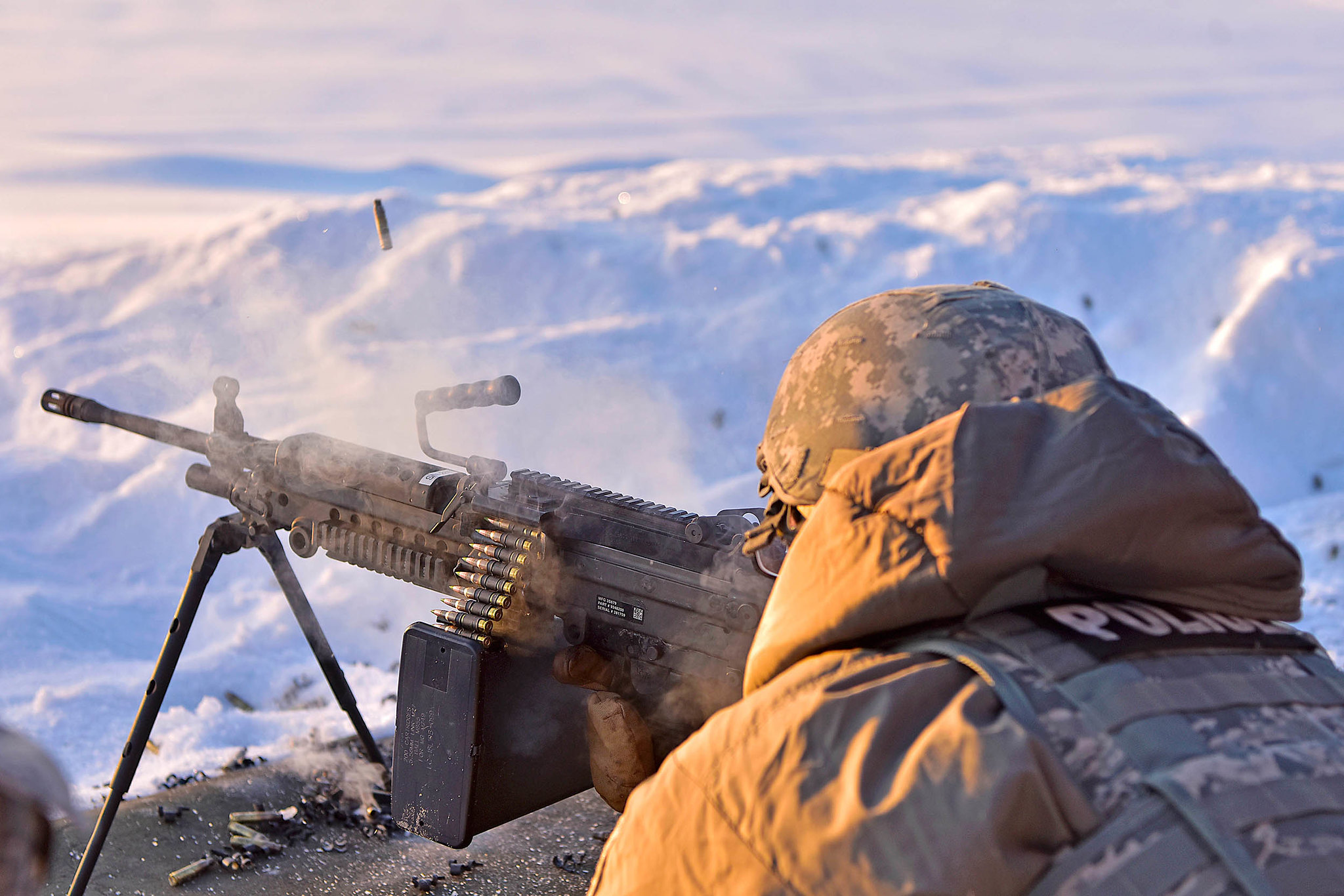 Airman Albert Menchaca, 354th Security Forces Squadron installation entry controller, fires an M-249 Squad Automatic Weapon at Eielson Air Force Base, Alaska, Jan. 9, 2020. (Senior Airman Beaux Hebert/Air Force)