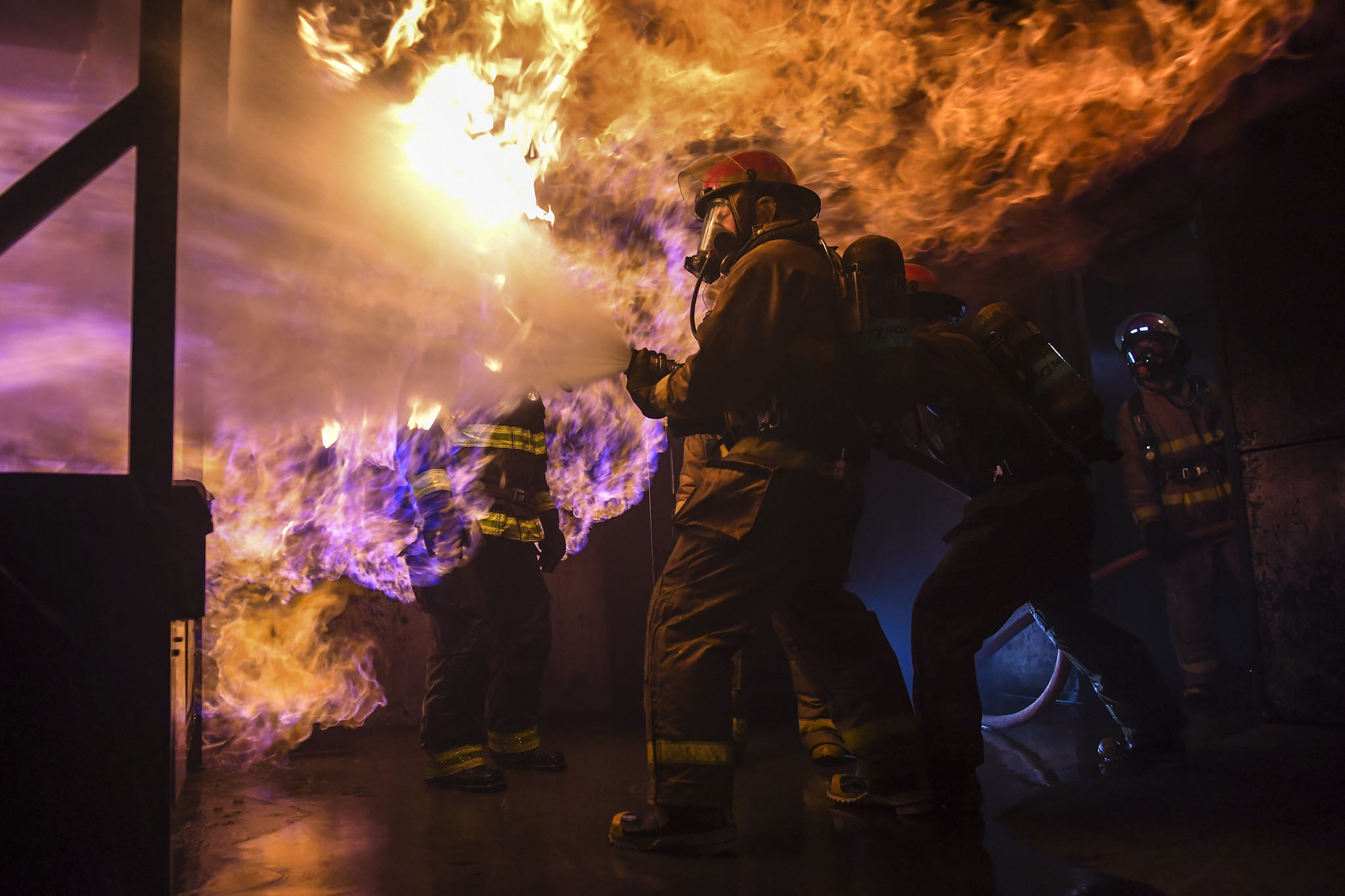 Sailors assigned to the aircraft carrier USS Carl Vinson (CVN 70) and the Arleigh Burke-class guided-missile destroyer USS Grimley (DDG 101) practice firefighting skills and techniques on May 15, 2019, by battling a simulated fire at the Bremerton International Emergency Services Training Center (BIESTC) in Washington state. (Mass Communication Specialist 2nd Class Wyatt L. Anthony/Navy)