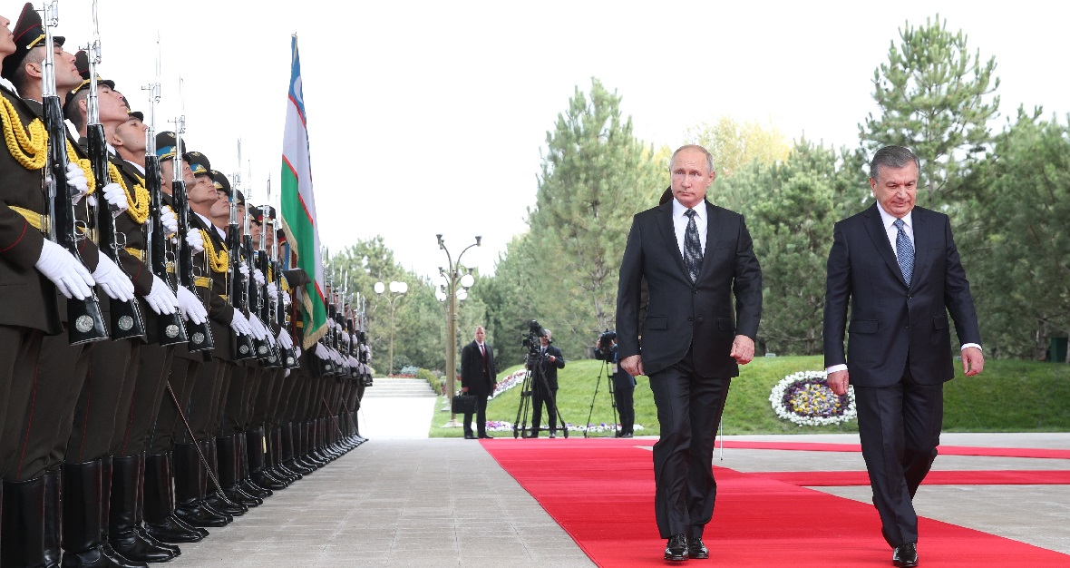 Russian President Vladimir Putin, left, and Uzbek President Shavkat Mirziyoyev walk past honor guard soldiers in Tashkent, Uzbekistan, on Friday, Oct. 19, 2018. Putin announced plans for the first nuclear power plant to be built in Uzbekistan and said the two countries may work together on military technology. (Pavel Bednyakov, Sputnik, Kremlin Pool/AP)