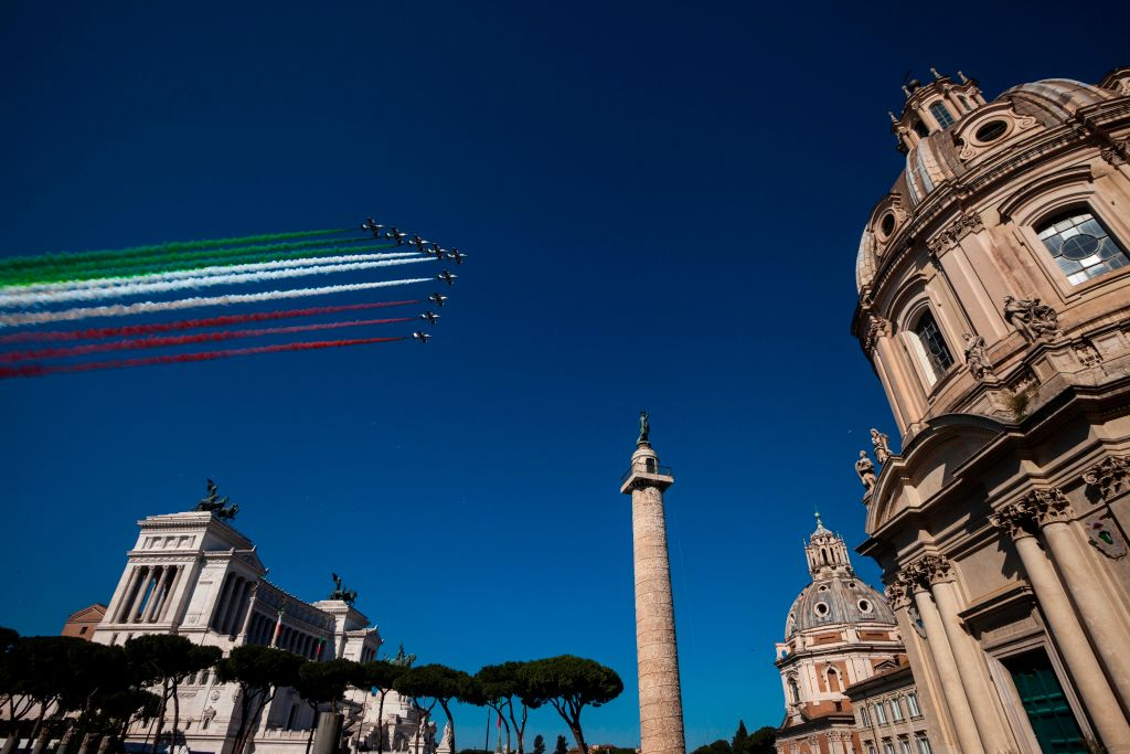 The Italian Air Force aerobatic unit Frecce Tricolori (Tricolor Arrows) spreads smoke with the colors of the Italian flag over (FromL) the Altare della Patria monument, Trajan's Column and the Santissimo Nome di Maria al Foro Traiano church (R) in the city of Rome on June 2, 2019 as part of the Republic Day ceremony. (LAURENT EMMANUEL/AFP/Getty Images)
