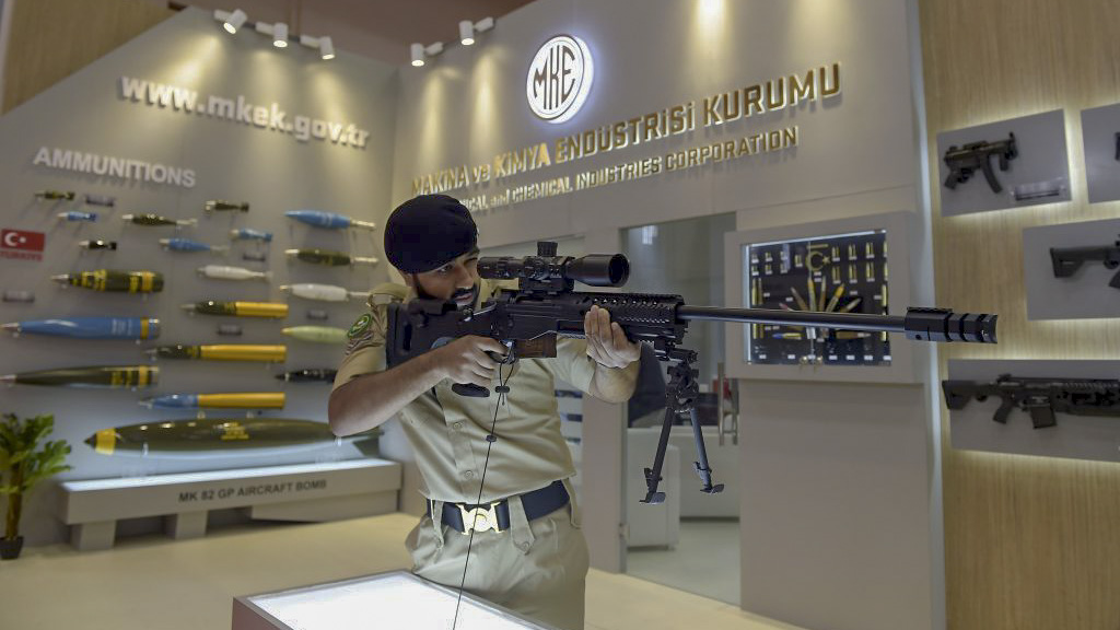 A Bahraini solider holds a rifle made by Turkish Mechanical and Chemical Industry Corporation (MKEK), during the opening of the Bahrain International Defence Exhibition and Conference (BIDEC) in the Bahraini capital Manama on October 28, 2019. (Photo by Mazen Mahdi / AFP via Getty)