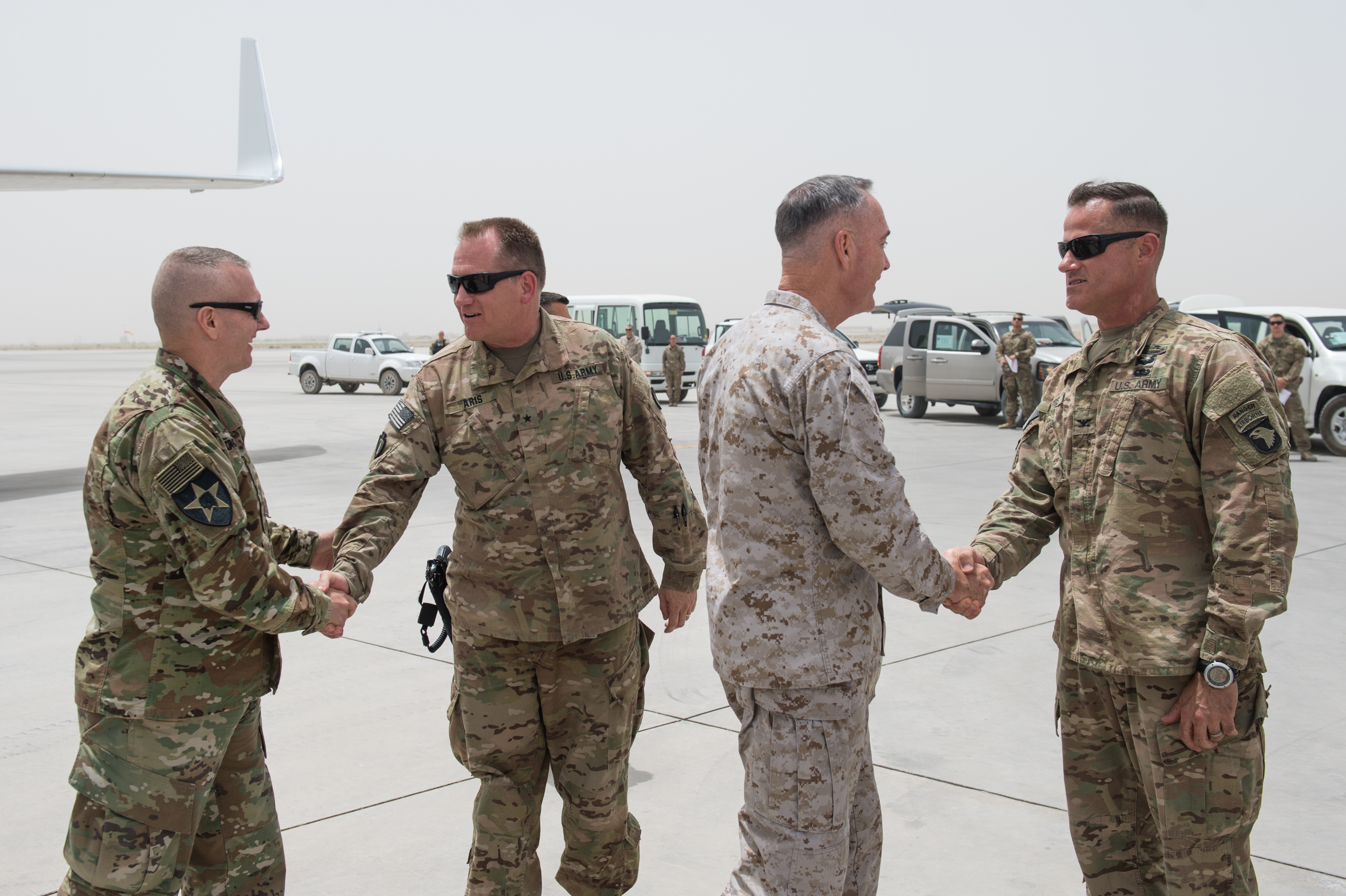Army Command Sgt. Maj. John W. Troxell, senior enlisted adviser to the chairman of the Joint Chiefs of Staff, and Marine Corps Gen. Joseph F. Dunford, Jr., then-chairman of the Joint Chiefs of Staff, greet Army leaders on the ground in Afghanistan in 2017. (Army Sgt. James K. McCann/DoD)