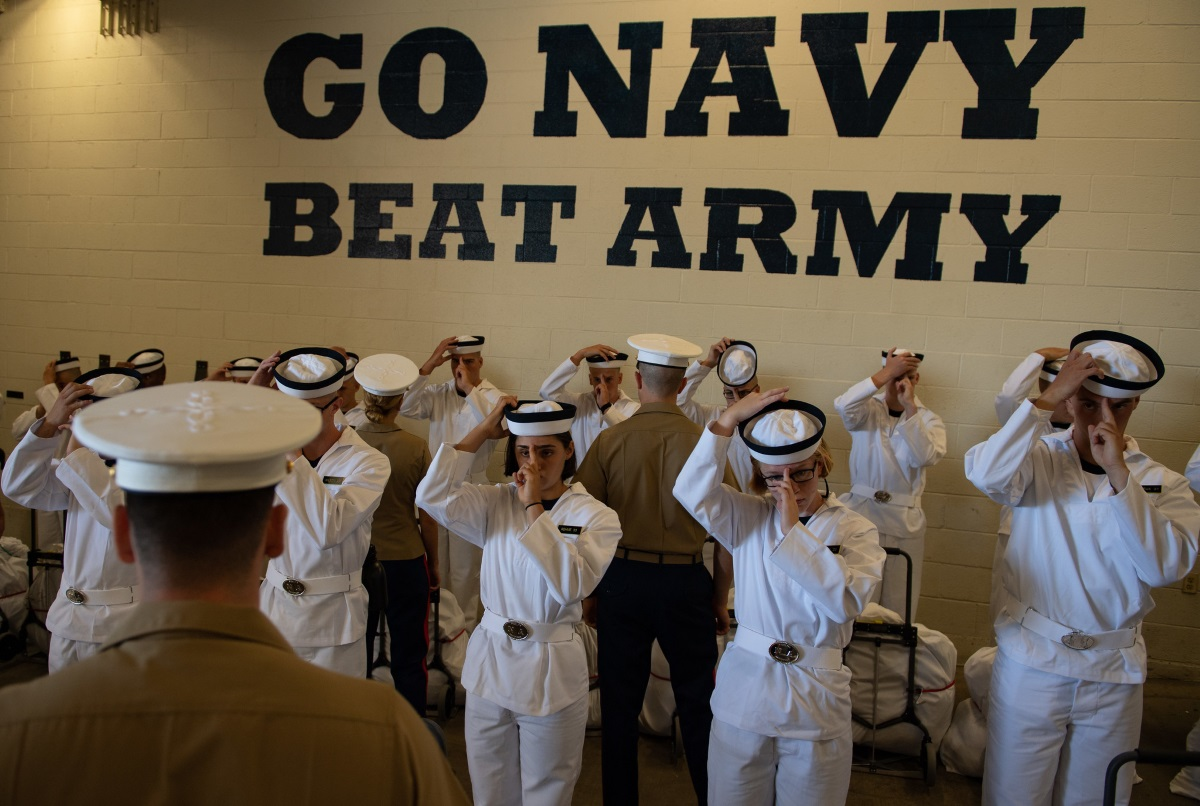 Plebes with the Class of 2023 don their covers at Induction Day on June 27, 2019, at the U.S. Naval Academy in Annapolis, Md. (U.S. Naval Academy)