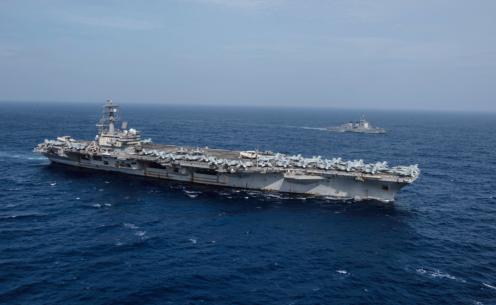 The Navy's forward-deployed aircraft carrier USS Ronald Reagan (CVN 76) sails alongside the Japan Maritime Self-Defense Force (JMSDF) guided-missile destroyer JS Myoko (DDG-175) on Aug. 15, 2019, while underway in the Philippine Sea. (Mass Communication Specialist 2nd Class Kaila V. Peters/Navy)