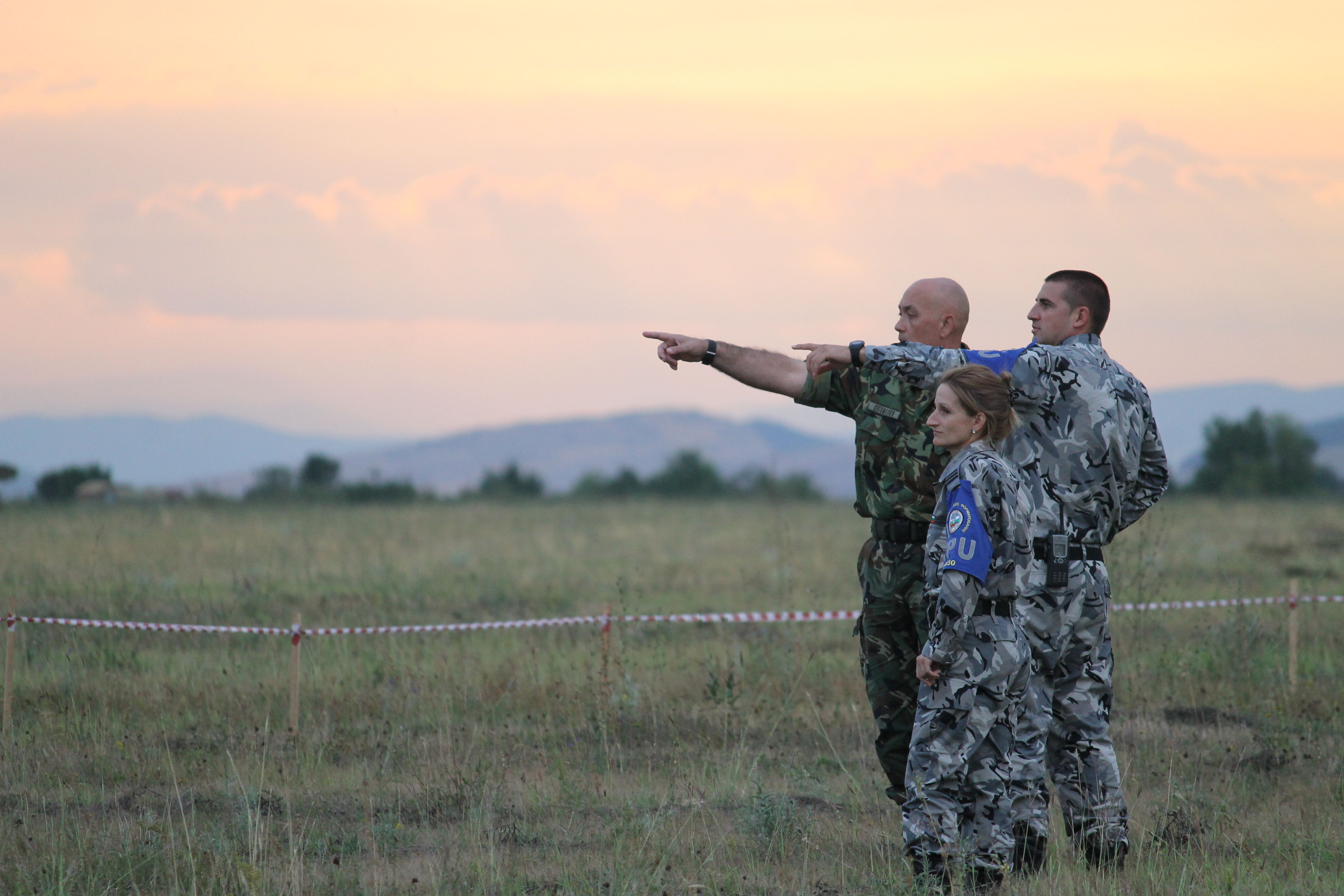 Bulgarian soldiers watch as paratroopers drop into the landing zone at sunset. Bulgaria was the lead host of the annual Saber Guardian exercise, which is a U.S. Army-led event that incorporates military activities in Hungary, Bulgaria and Romania. (Jen Judson/Staff)