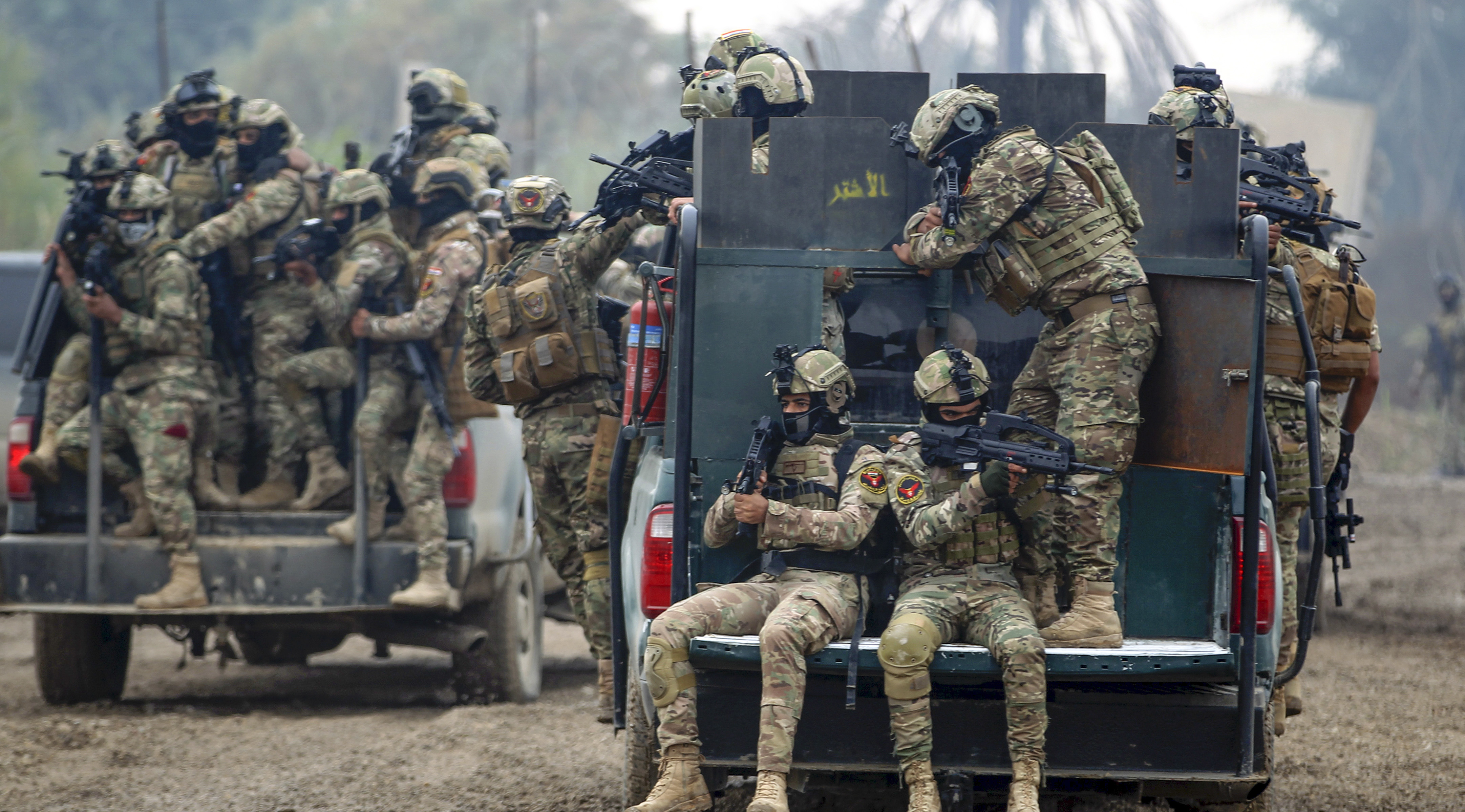 Members of Iraq's Rapid Response military unit take part in a
