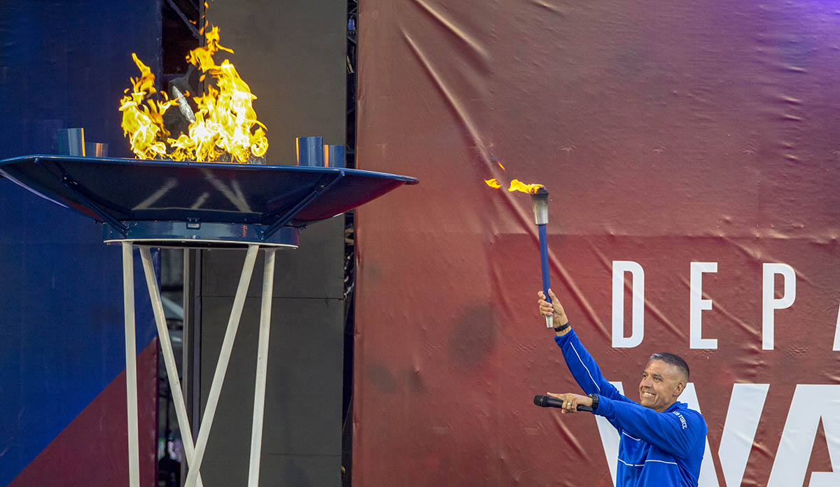 Retired Air Force Master Sgt. Shanon Hampton reacts to being the final torch bearer in the torch lighting event during opening ceremonies for the 2018 Warrior Games at the Air Force Academy in Colorado Springs, Colo. June 2, 2018. (EJ Hersom/DoD)