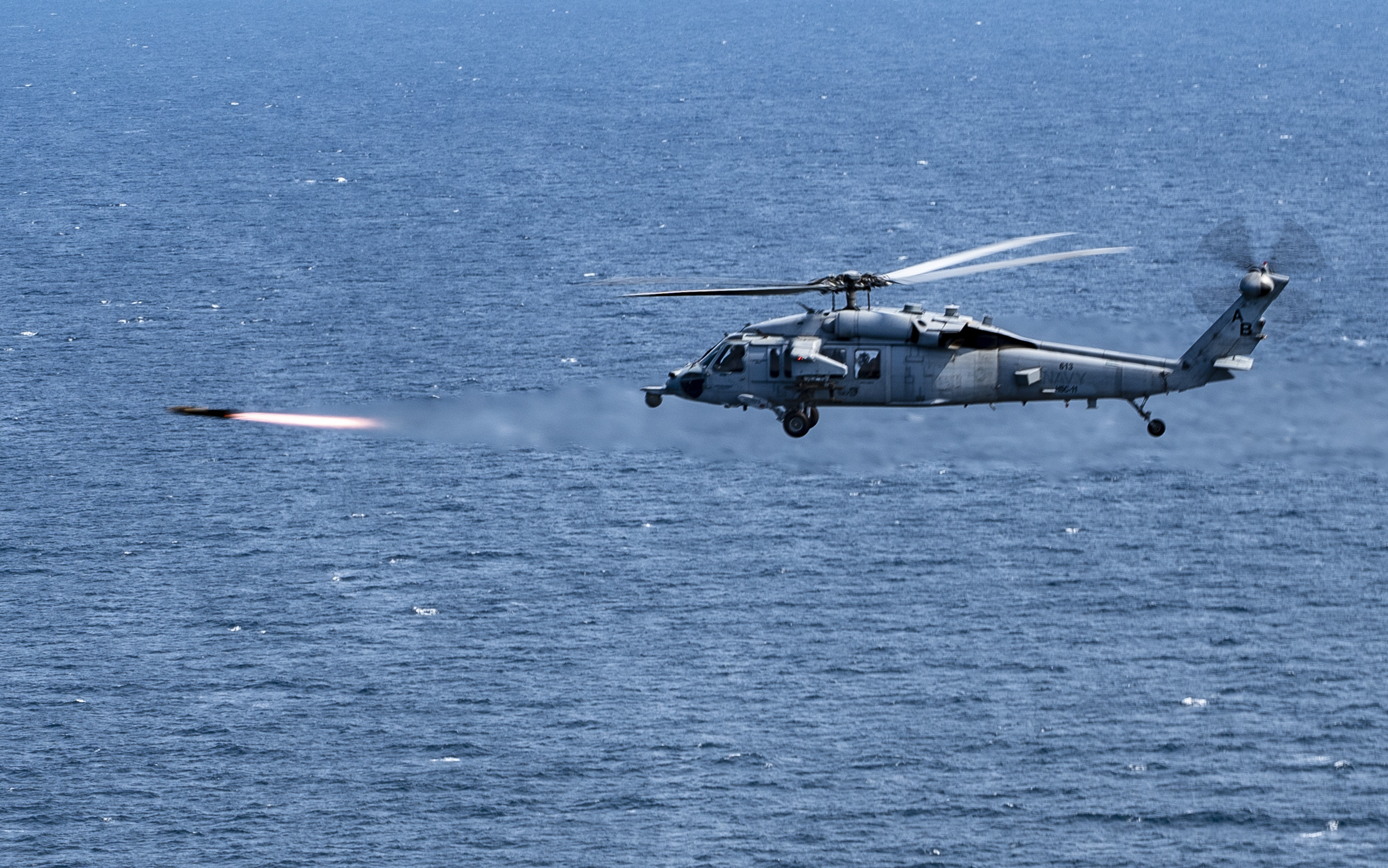 An MH-60S Seahawk fires an AGM-114 Hellfire missile during exercise Savage Ice. The Joint Air-to-Ground Missile will ultimately replace the Hellfire missile used across the services. (MC3 Trey Hutcheson/U.S. Navy)