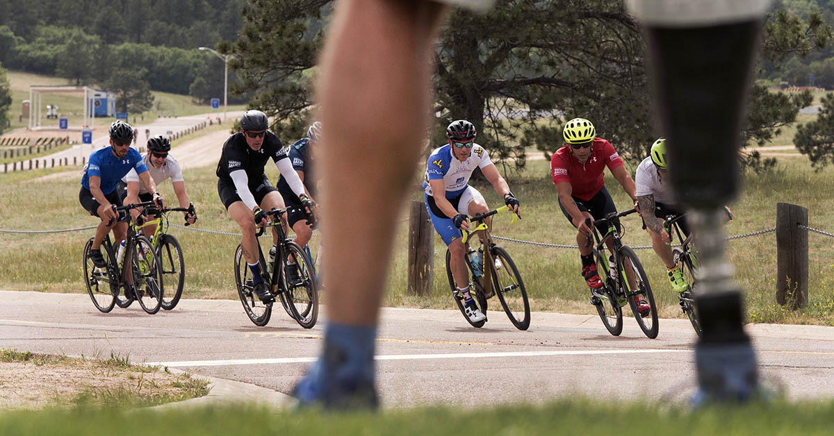 SOCOM veteran and former athlete Shawn Mello stands near the race course as wounded, ill and injured service members and veterans compete in cycling during the 2018 DoD Warrior Games at the U.S. Air Force Academy in Colorado Springs on June 6, 2018. (Roger L. Wollenberg/DoD)