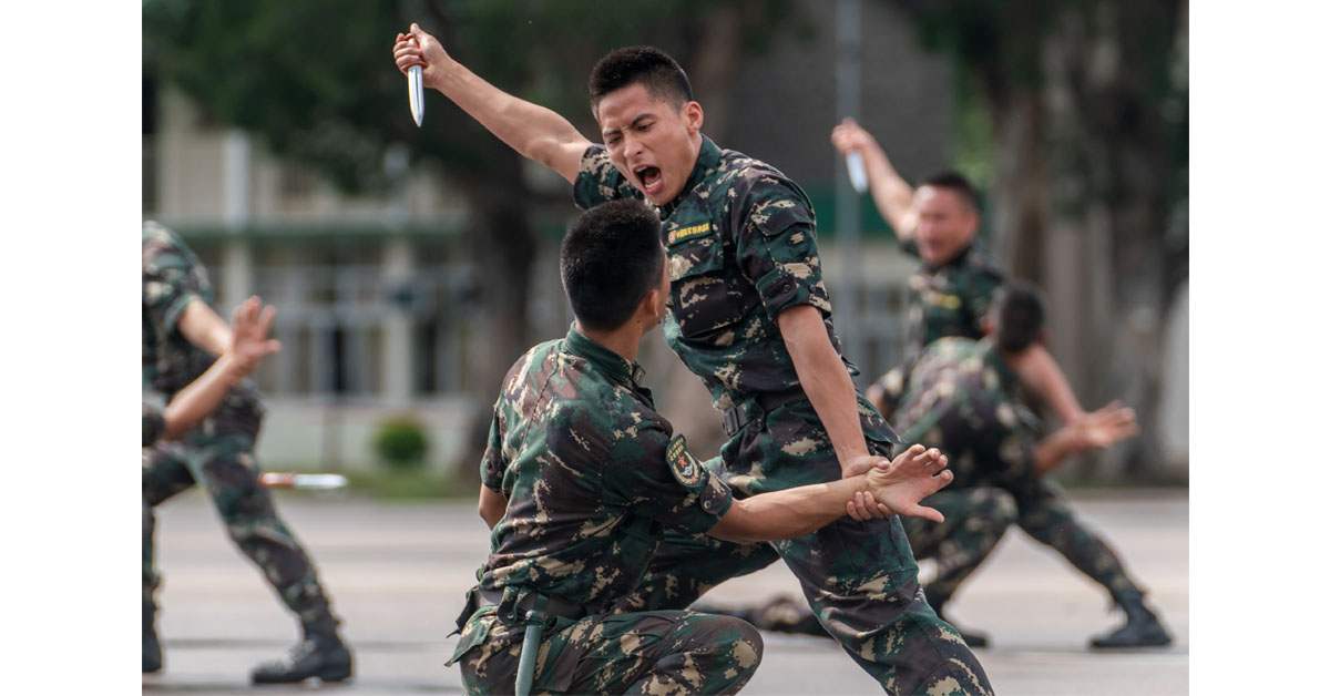Members of the Chinese People's Liberation Army perform drills during a demonstration at an open day at the Shek Kong Barracks on June 30, 2018, in Hong Kong. (Anthony Kwan/Getty Images)