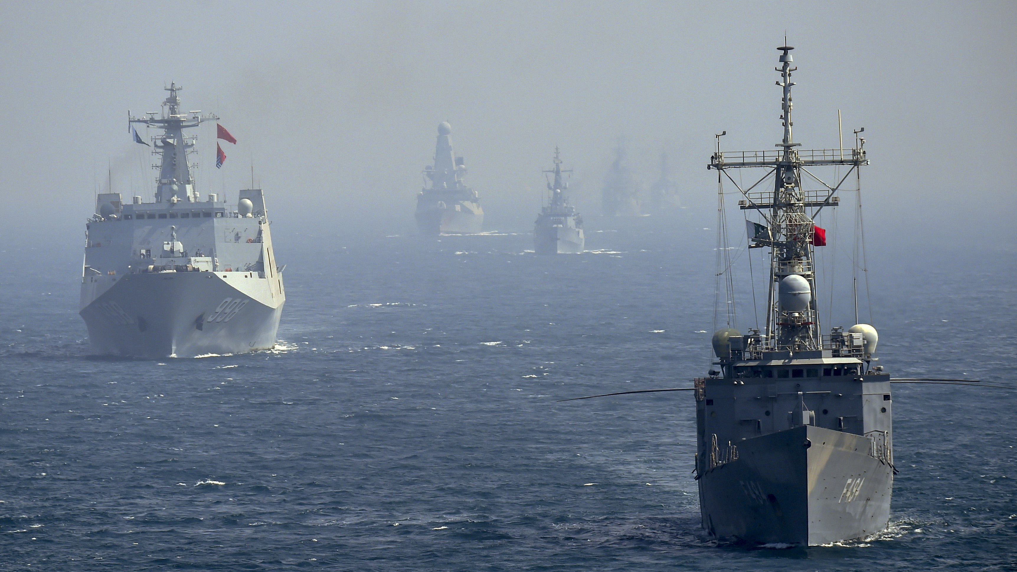 Naval ships from Turkey (R) and China (L) take part in the multinational naval exercises 'AMAN-19' in the Arabian Sea near Pakistan's port city of Karachi on February 11, 2019. - Exercise Aman took place from February 8-12, with some 45 countries participating with ships and observers. (ASIF HASSAN/AFP/Getty Images)