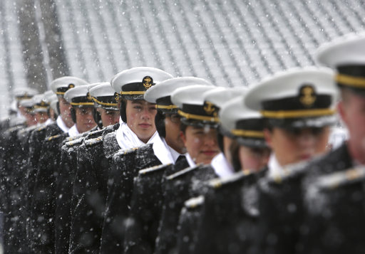 Navy midshipman practice their pregame formation as snow falls before Saturday's annual Army-Navy game in Philadelphia. (Jacqueline Larma/AP)
