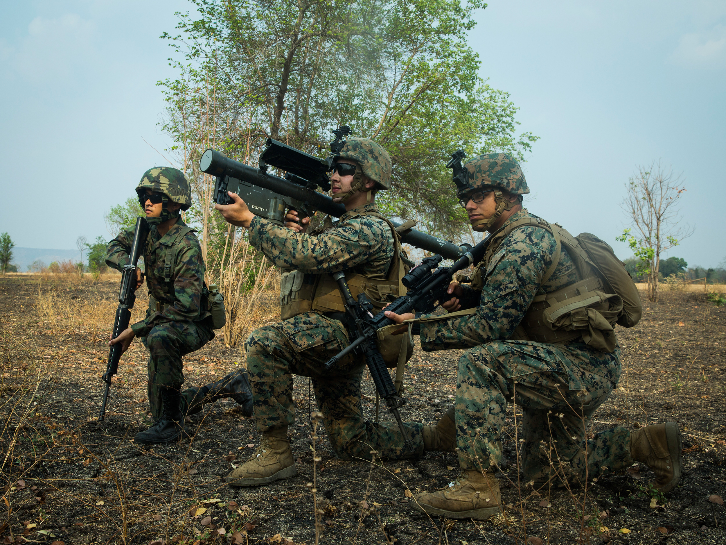 A U.S. Marine and Royal Thai Marine hold security as another Marine sights in with an FIM-92A Stinger missile launcher on March 2, 2020, during a combined joint High Mobility Rocket System rapid insertion as part of Cobra Gold 2020 at Chandy Range, Kingdom of Thailand. (Sgt. Audrey M. C. Rampton/Marine Corps)