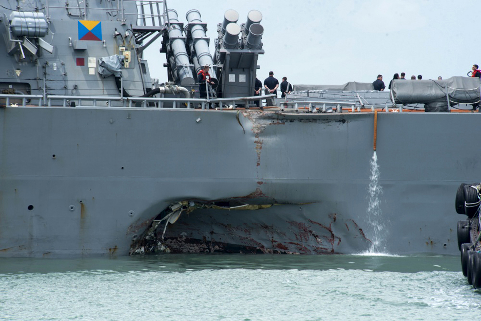 Stricken destroyer John S. McCain arrives in Singapore, 10 crew still missing