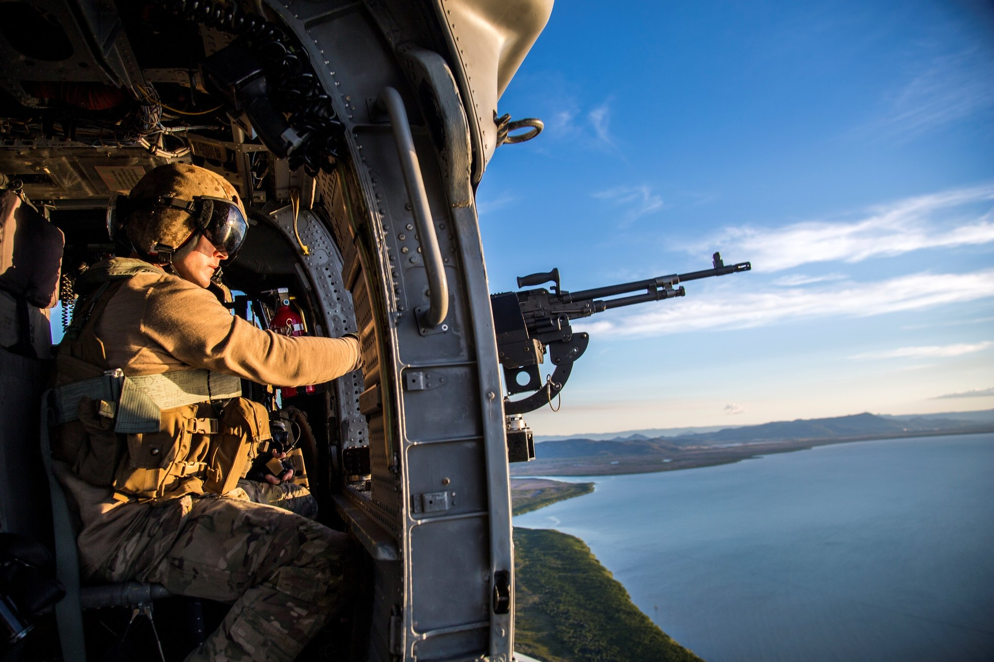 A crew chief scans the skies while on a mission to emplace U.S. and Australian special operations forces during Talisman Sabre, July 12, 2019, in Queensland, Australia. (Lance Cpl. Nicole Rogge/Marine Corps)
