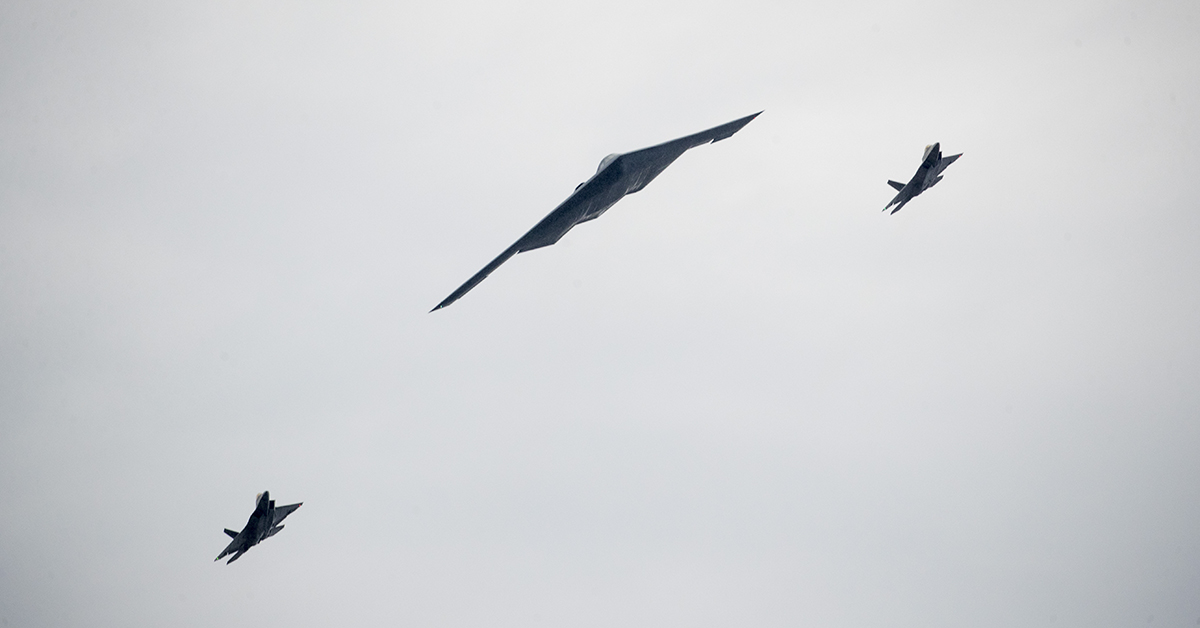 U.S. Air Force aircraft B-2 and two F-22 fly overhead as President Donald Trump speaks during an Independence Day celebration in front of the Lincoln Memorial, Thursday, July 4, 2019, in Washington. (AP Photo/Andrew Harnik)