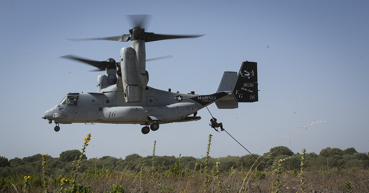 A Marine with Special Purpose Marine Air-Ground Task Force-Crisis Response-Africa fast-ropes out of a U.S. Marine Corps MV-22 Osprey at Naval Station Rota, Spain, June 26, 2018. SPMAGTF-CR-AF deployed to conduct crisis-response and theater-security operations in Europe and North Africa. (Staff Sgt. Britni M. Garcia Green/Marines)