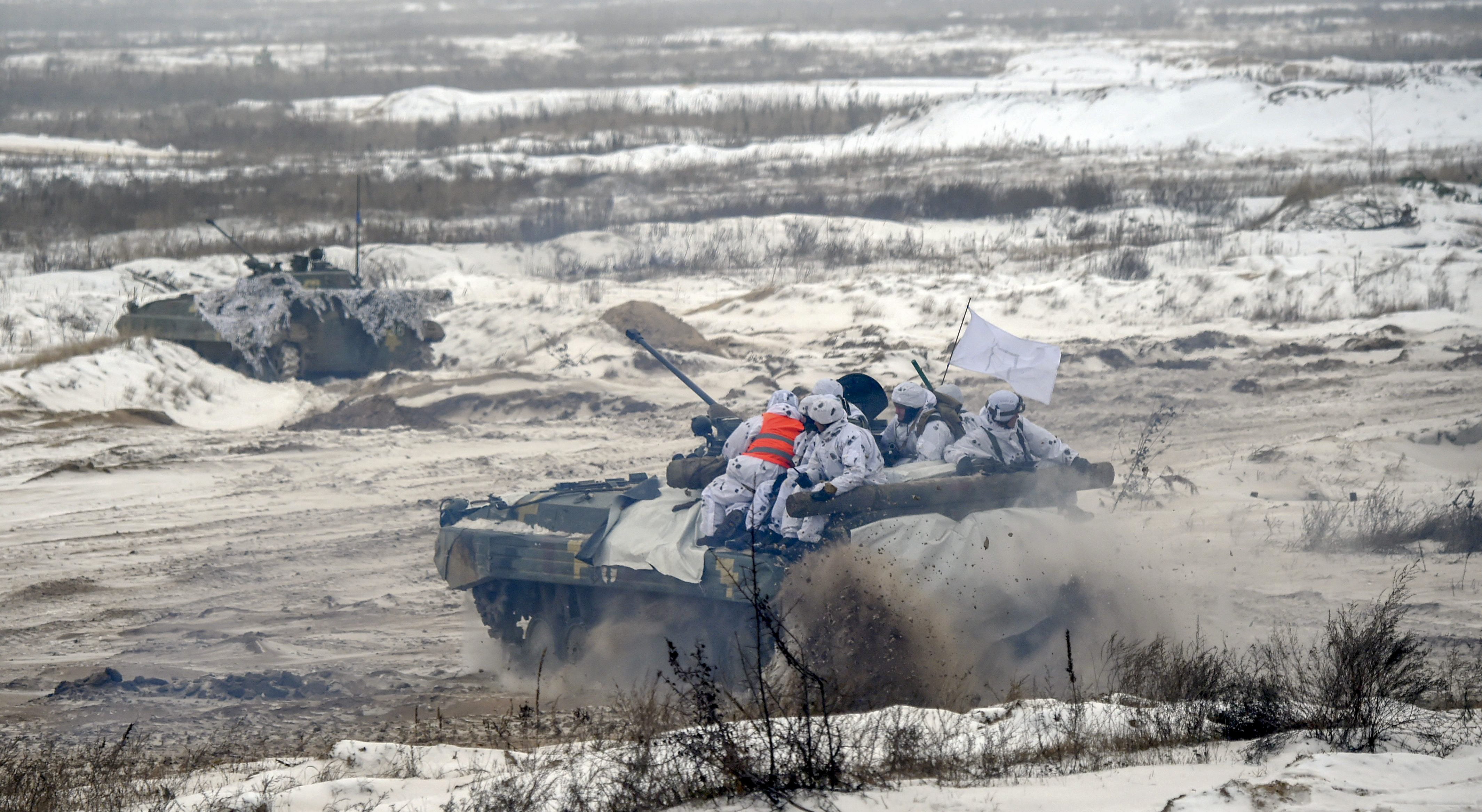 Ukrainian servicemen on armored personal carriers (APC) take part in brigade tactical exercises with combat shooting near Goncharivske willage, Chernihiv region, not far from the border with Russia on December 3, 2018. - Tensions between Ukraine and Russia rose on November 25, when Russian forces seized three Ukranian navy vessels and their crew. Ukraine imposed martial law for 30 days in 10 regions that border Russia, the Black Sea and the Azov Sea on November 28. (SERGEI SUPINSKY/AFP/Getty Images)