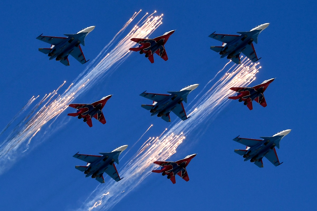 Russia's MiG-29 fighters of the Strizhi aerobatic team and Su-30 jet fighters of the Russkiye Vityazi aerobatic team fly over Red Square during the Victory Day military parade. (Kirill Kudryavtsev/AFP via Getty Images)