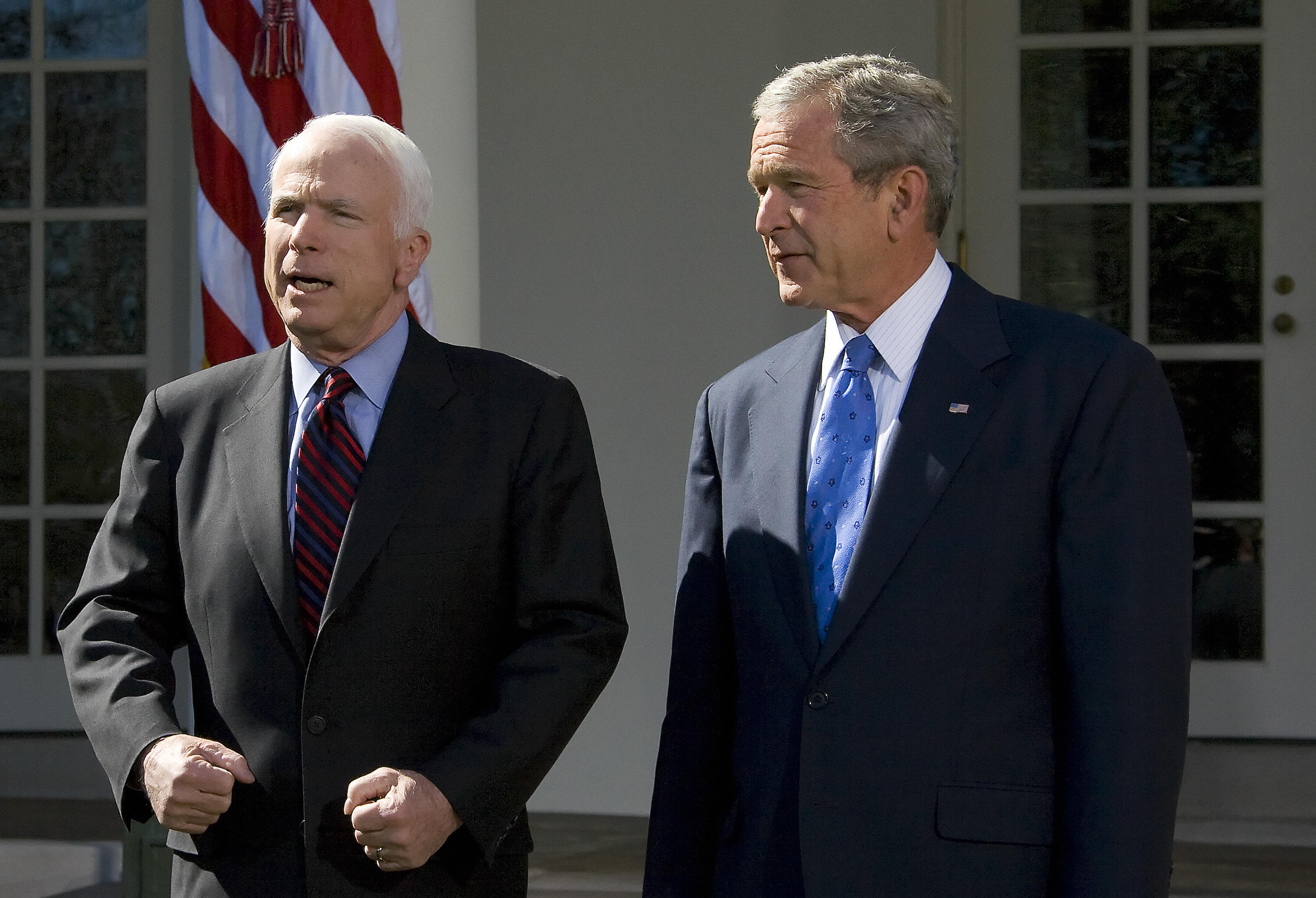U.S. President George W. Bush, right, listens after endorsing Republican presidential candidate John McCain in the Rose Garden of the White House on March 5, 2008. McCain had lost to Bush for the presidency in 2000. (Jim Watson/AFP via Getty Images)