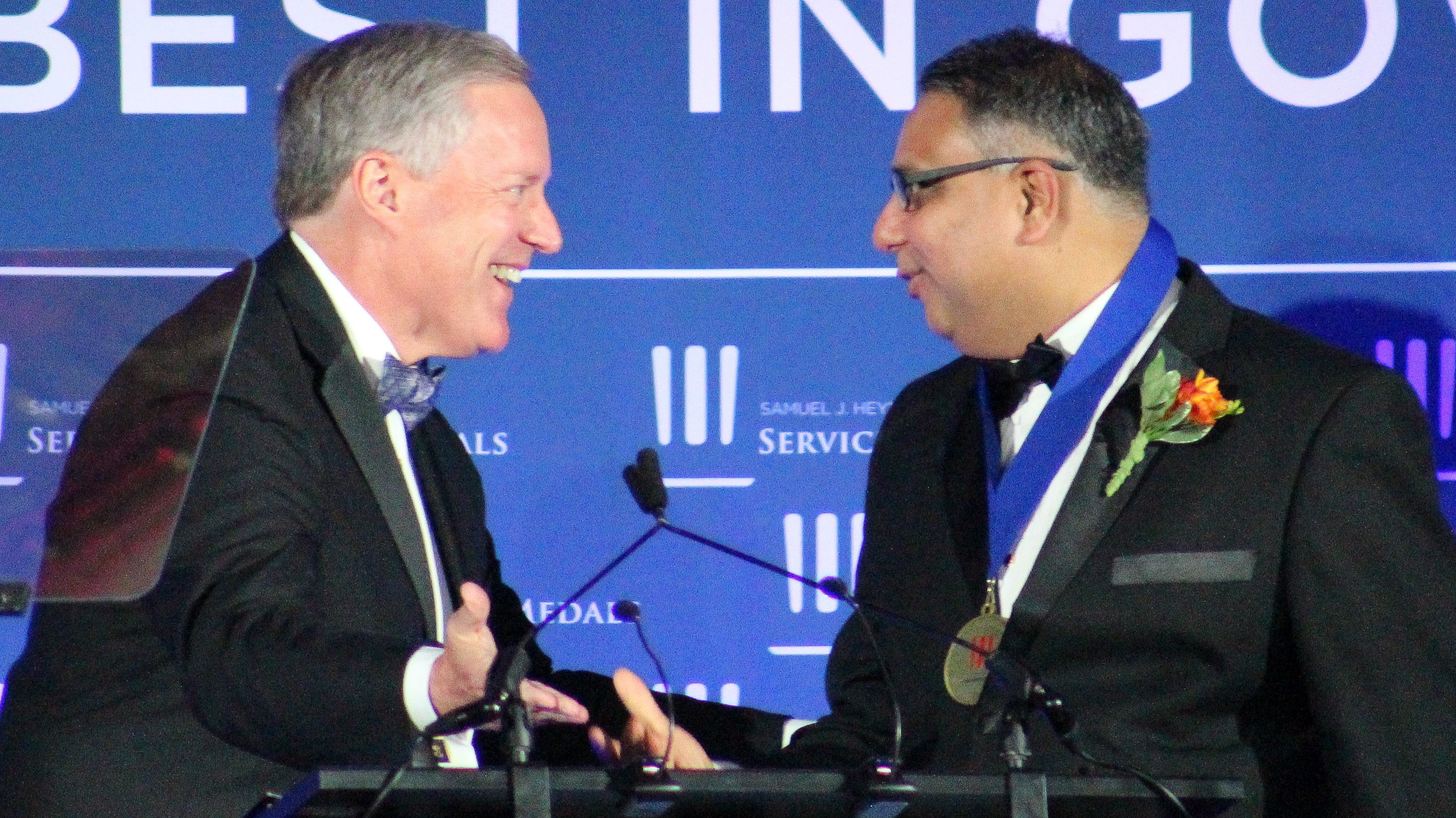 Rep. Mark Meadows, R-N.C., presents Parimal Kopardekar, senior technologist for Air Transportation Systems at NASA's Ames Research Center, with the Promising Innovations Medal at the 2018 Sammies Gala. (Jessie Bur/Staff)