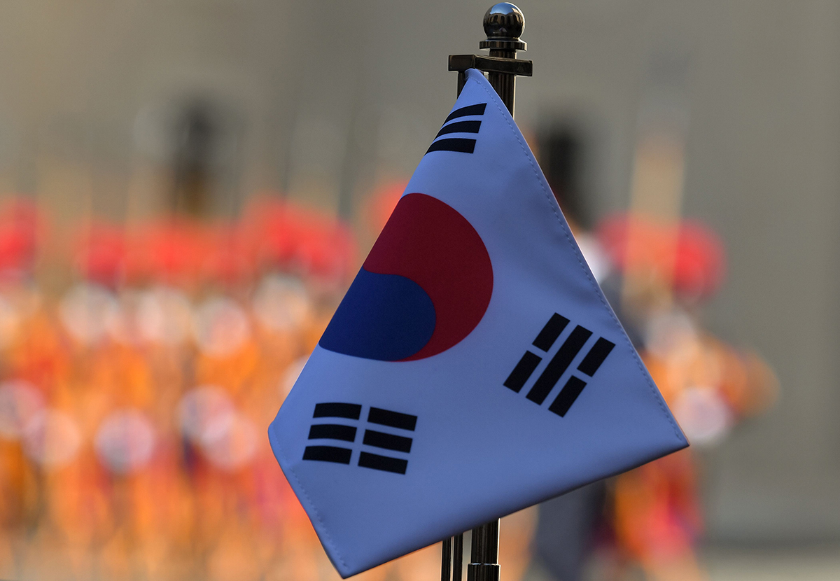 The flag of South Korea, also known as the Taegukgi, is pictured against Swiss Guards (Rear) at the Vatican prior to a private audience of South Korea's president with the Pope on Oct. 18, 2018. (Tiziana Fabi/AFP via Getty Images)