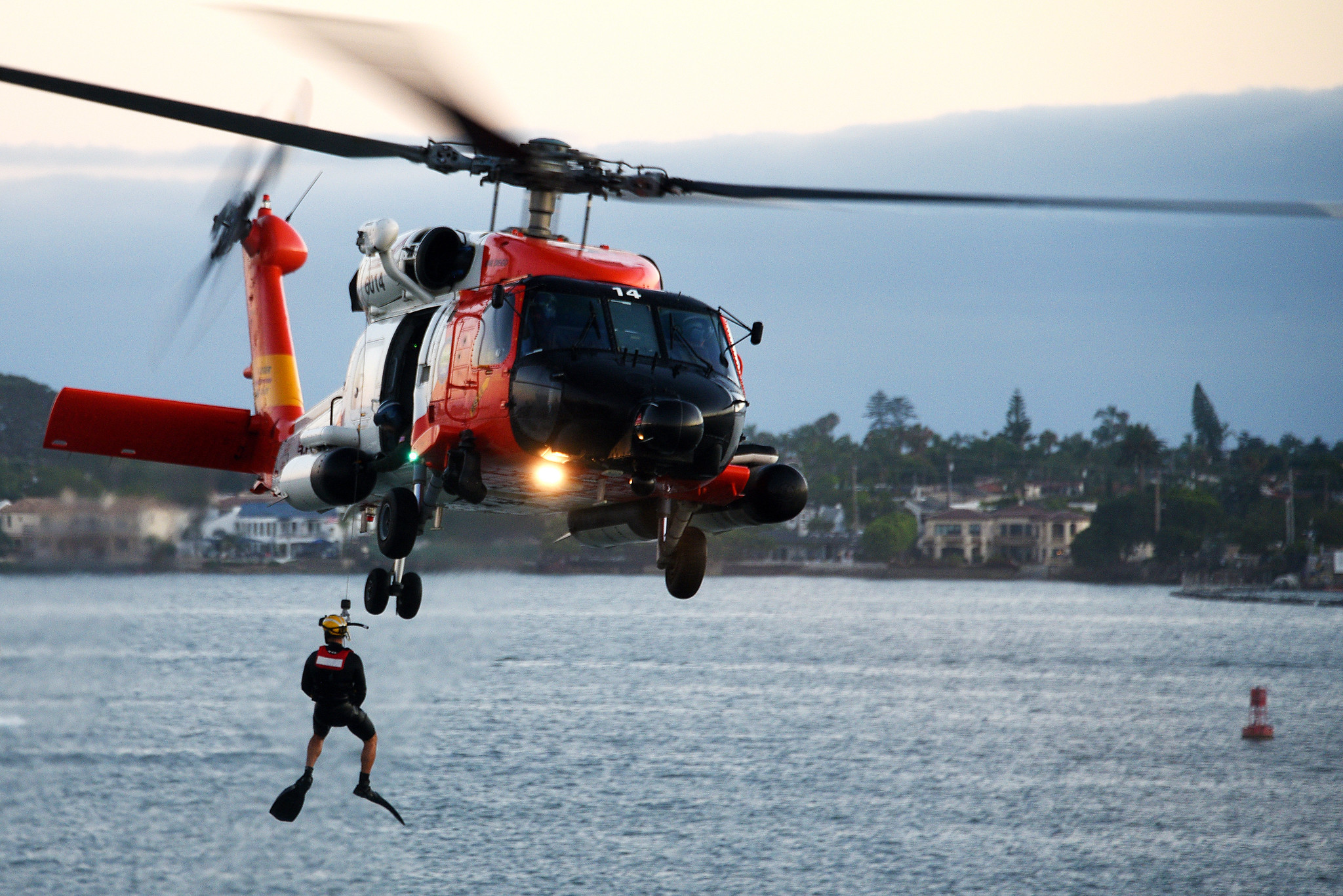 A U.S. Coast Guard Sector San Diego MH-60T Jayhawk helicopter crew conducts a search and rescue demonstration in San Diego, Aug. 10, 2019. (Petty Officer 1st Class Patrick Kelley/Coast Guard)