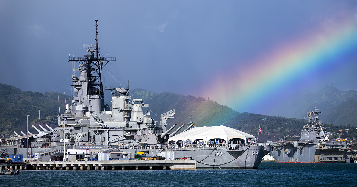A rainbow forms over the USS Missouri Battleship Memorial as it sits moored at Ford Island during the 2018 Rim of the Pacific exercise. Twenty-five nations, 46 ships, five submarines, about 200 aircraft and 25,000 personnel are participating in RIMPAC from June 27 to Aug. 2 in and around the Hawaiian Islands and Southern California. (MC2 Justin R. Pacheco/Navy)