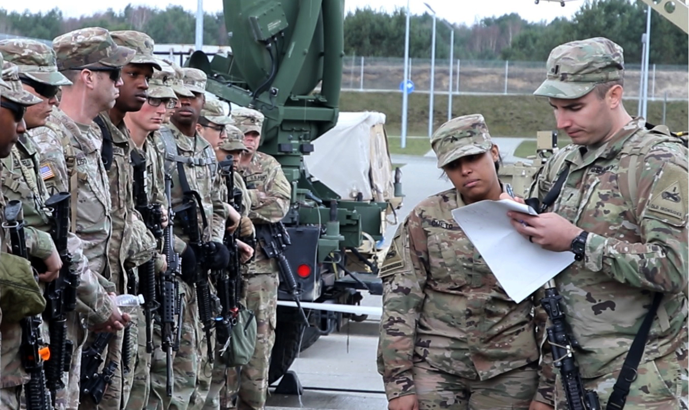 Soldiers with 1st Battalion, 35th Armor Regiment, 2nd Armored Brigade Combat Team, 1st Armored Division from Fort Bliss, Texas, check in for roll call after arriving at Drawsko Pomorskie Training Area, Poland on March 19, 2019. The soldiers are in Poland as part of an emergency deployment readiness exercise. (Army)