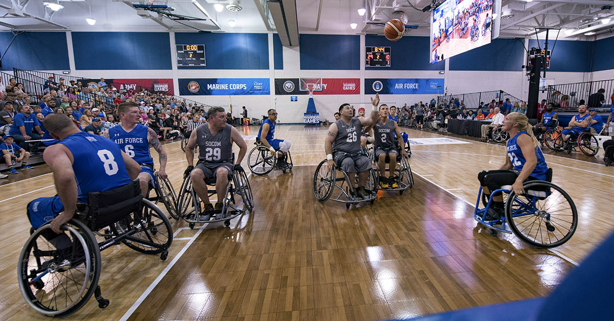 Athletes for Team Air Force and Team SOCOM (U.S. Special Operations Command) play basketball during a DoD Warrior Games wheelchair basketball game, June 4, 2018, at the U.S. Air Force Academy in Colorado Springs, Colorado. The Warrior Games are an annual event, established in 2010, to introduce wounded, ill and injured service members to adaptive sports as a way to enhance their recovery and rehabilitation. (Staff Sgt. Carlin Leslie/DoD)