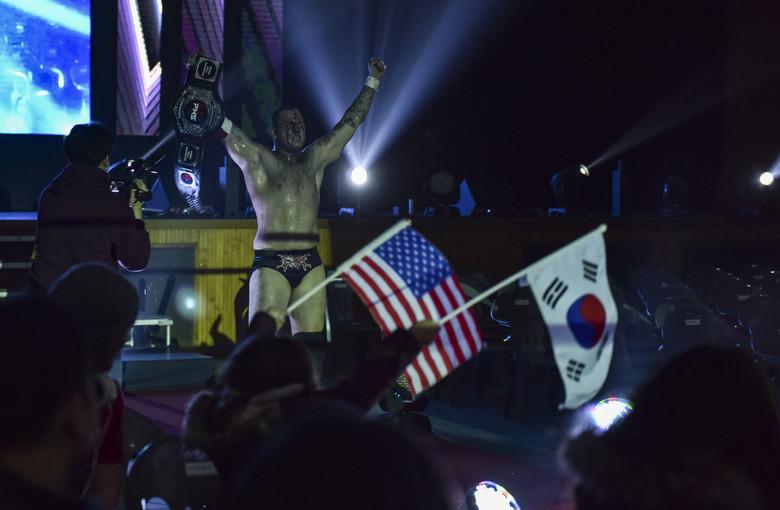 Air Force Tech. Sgt. Gregory Gauntt (Ryan Oshun) celebrating his winning wrestling match in Pyeongtaek, South Korea, on Feb. 9, 2019. (Senior Airman Stefan Alvarez/Air Force)
