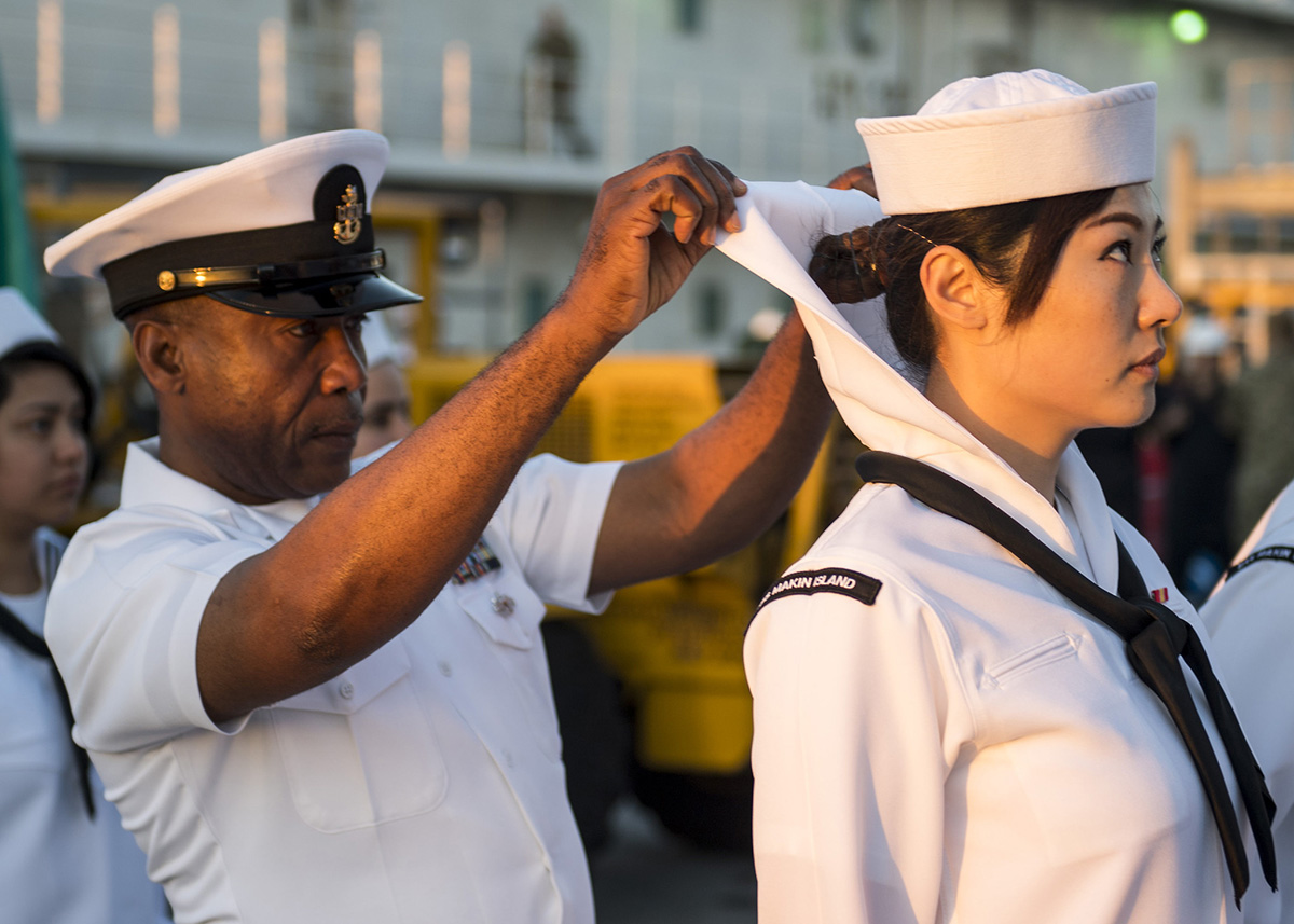 Senior Chief Aviation Support Equipment Technician Augustine Ilomuanya conducts a dress white uniform inspection on March 22, 2019, aboard the amphibious assault ship USS Makin Island (LHD 8). (Mass Communication Specialist 2nd Class Colby A. Mothershead//Navy)