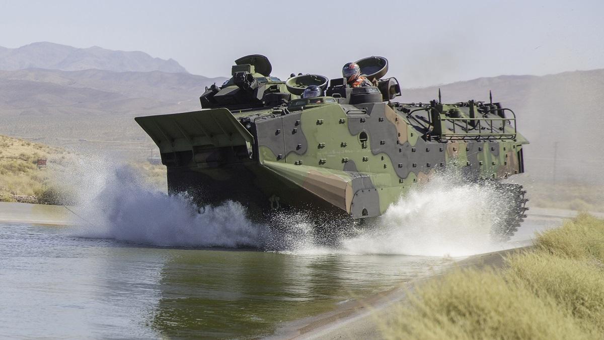 Pentagon employees roll the Assault Amphibious Vehicle into a testing pond aboard Marine Corps Logistics Base Barstow, Calif., on Aug. 27, 2018. (Jack J. Adamyk/U.S. Marine Corps)