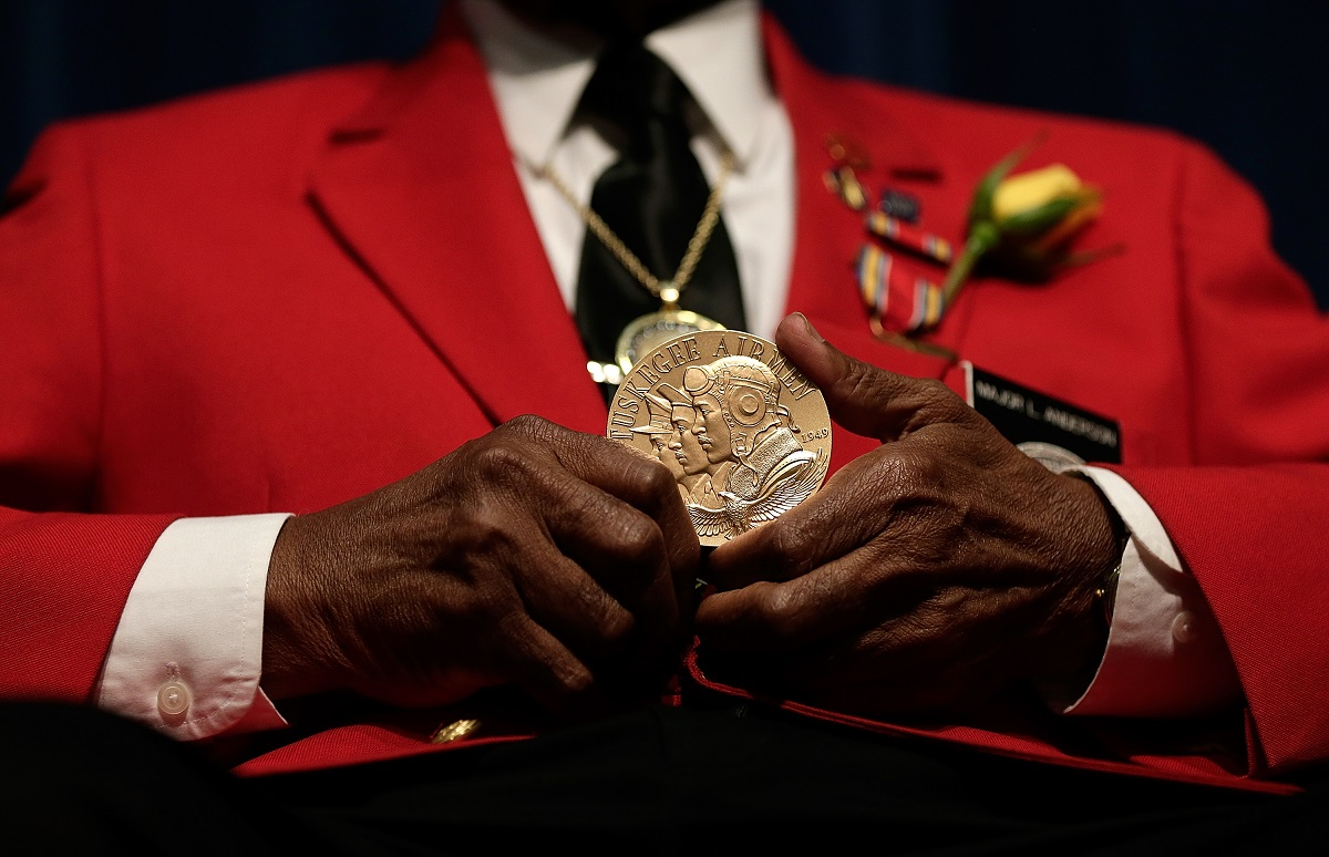 Tuskegee Airman Major Anderson shows off a Congressional Gold Medal given to all Tuskegee Airmen during a ceremony commemorating Veterans Day and honoring the group of World War II airmen Nov. 11, 2013, in Washington. (Win McNamee/Getty Images)