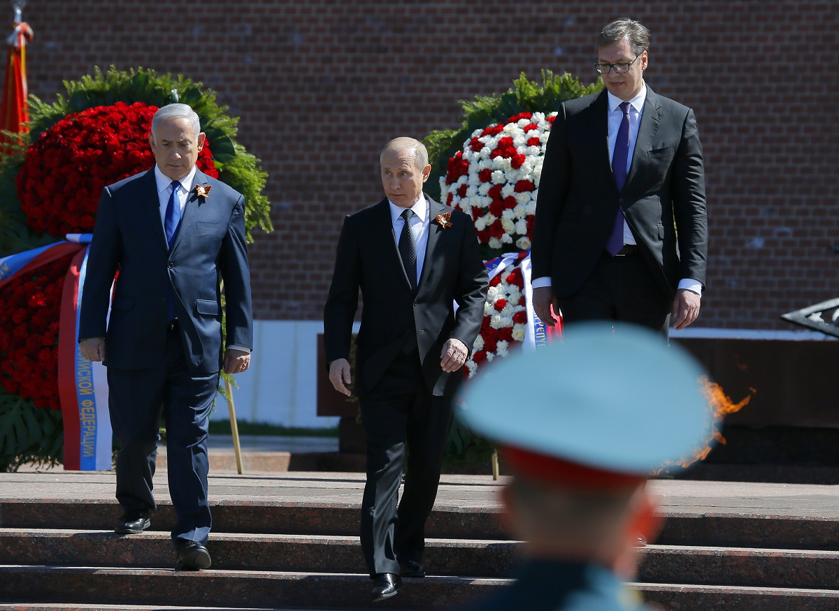 Russian President Vladimir Putin, center, Serbian President Aleksandar Vucic, right, and Israeli Prime Minister Benjamin Netanyahu attend a wreath-laying ceremony at the Tomb of the Unknown Soldier after the Victory Parade. (Alexander Zemlianichenko/AP)