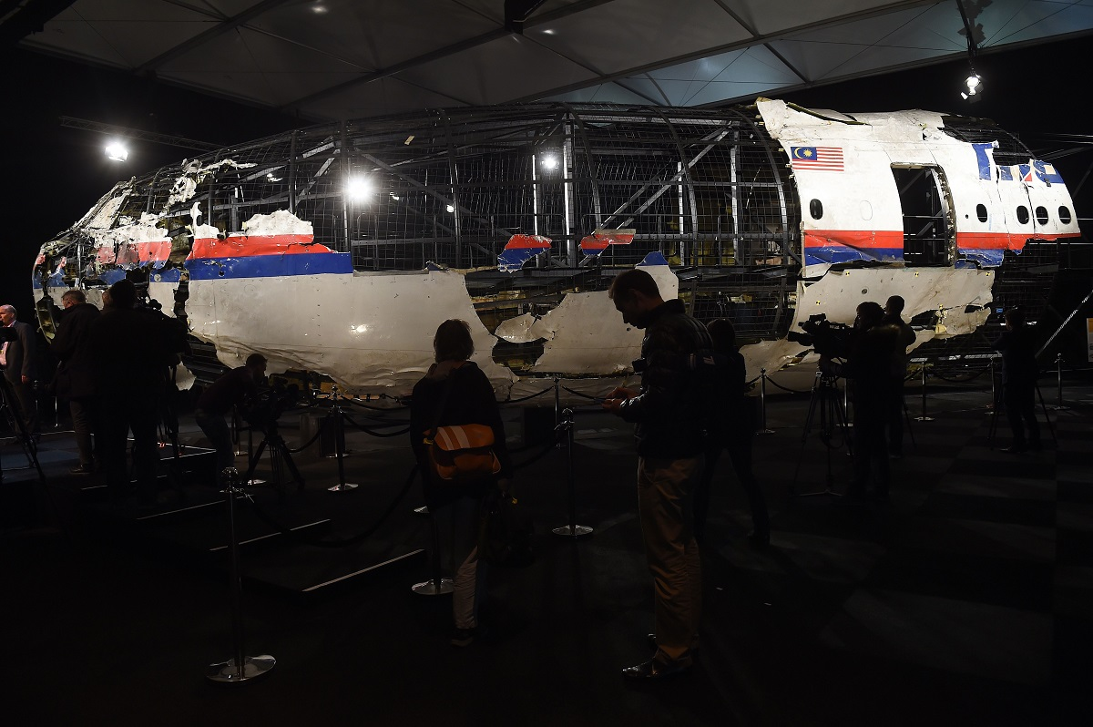 The wrecked cockpit of Malaysia Airlines Flight MH17 is presented to the press at the Gilze Rijen air base on Oct. 13, 2015. (Emmanuel Dunand/AFP via Getty Images)