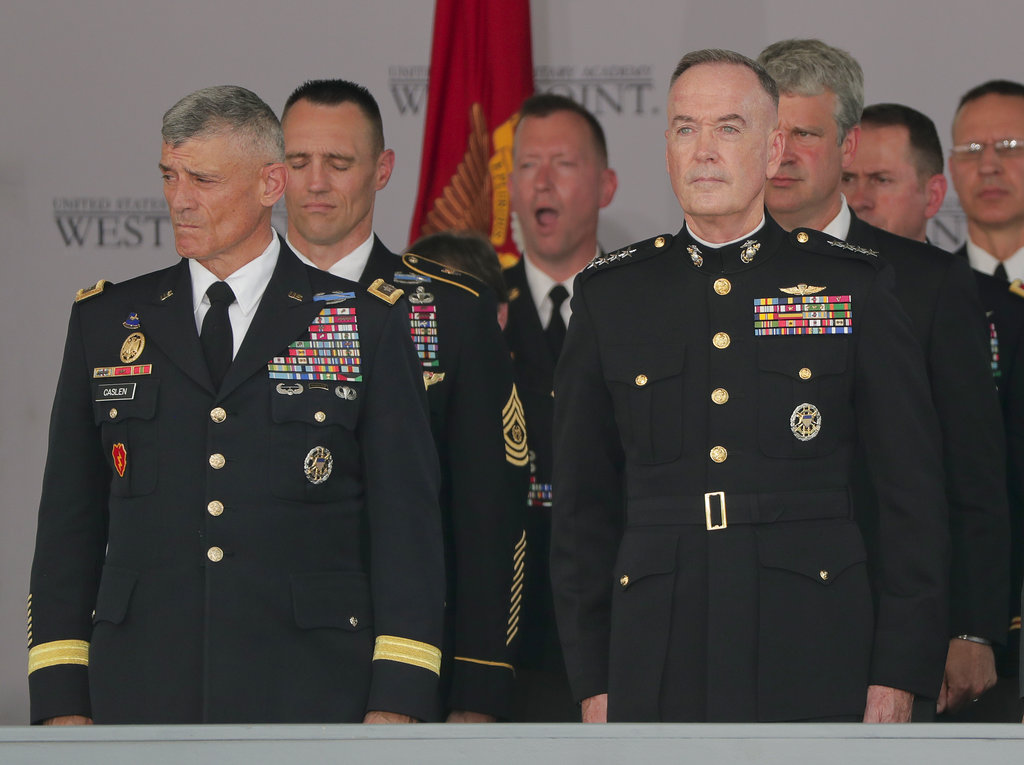 Lt. Gen. Robert Caslen Jr., superintendent at West Point, left, and General Joseph F. Dunford Jr., chairman of the Joint Chiefs of Staff, stand during the singing of