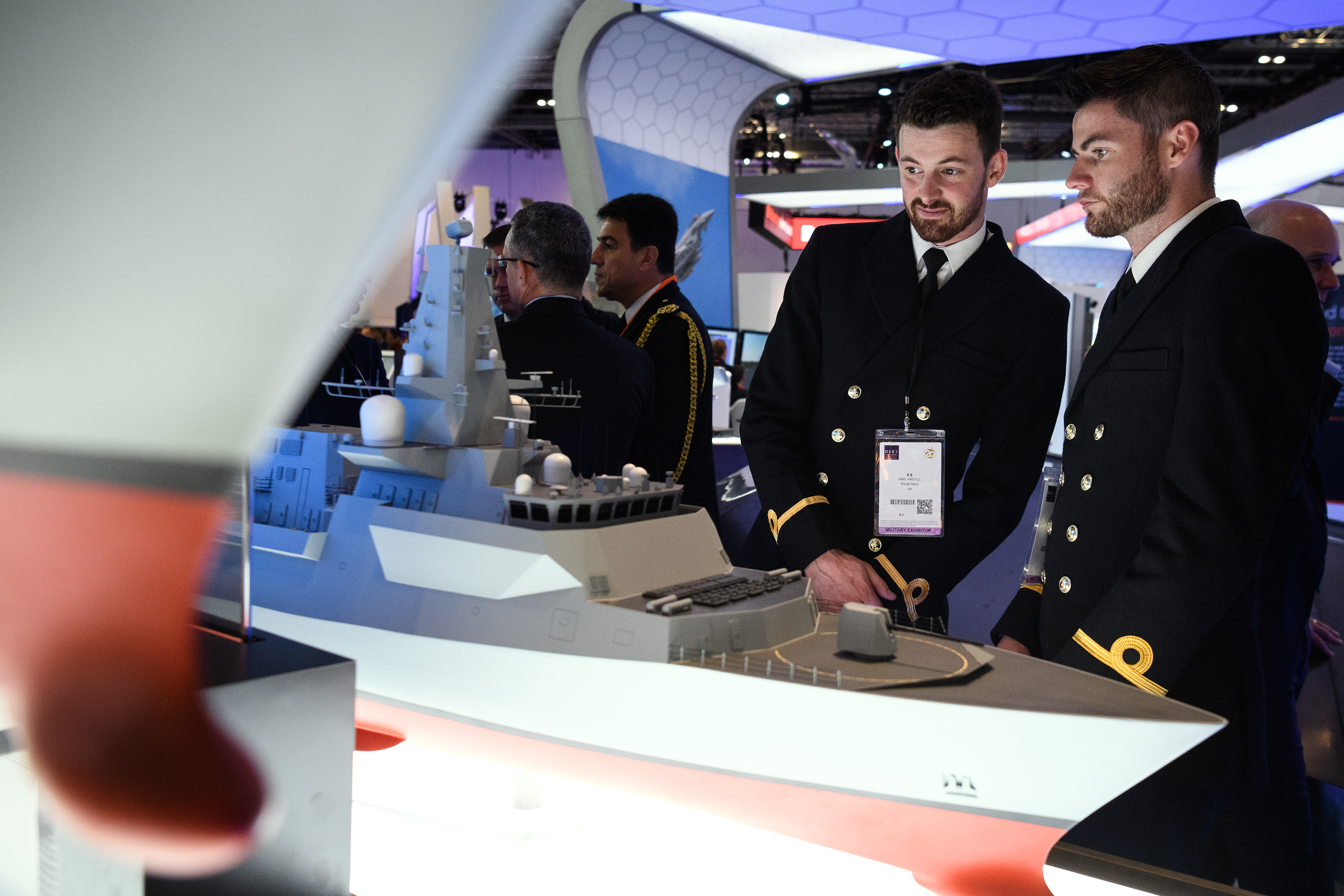 Two men look at a model of a Type 26 frigate at the BAE Systems stand at DSEI. (Leon Neal/Getty Images)