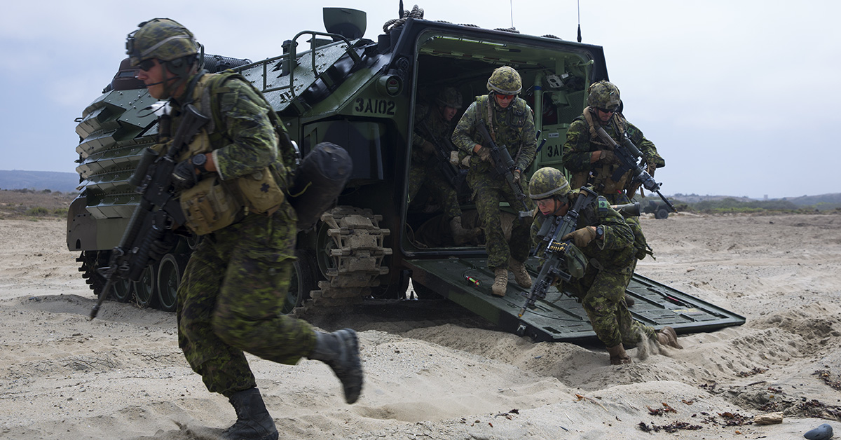 Canadian soldiers with the Royal 22e RŽgiment exit an AAV-P7/A1 assault amphibious vehicle during an amphibious raid as part of Rim of the Pacific (RIMPAC) exercise on Marine Corps Base Camp Pendleton, California, July 13, 2018. This evolution provided an opportunity for participating nations to share best practices which included loading and unloading drills as well as squad attacks. (Cpl. Robert G. Gavaldon/Marines)