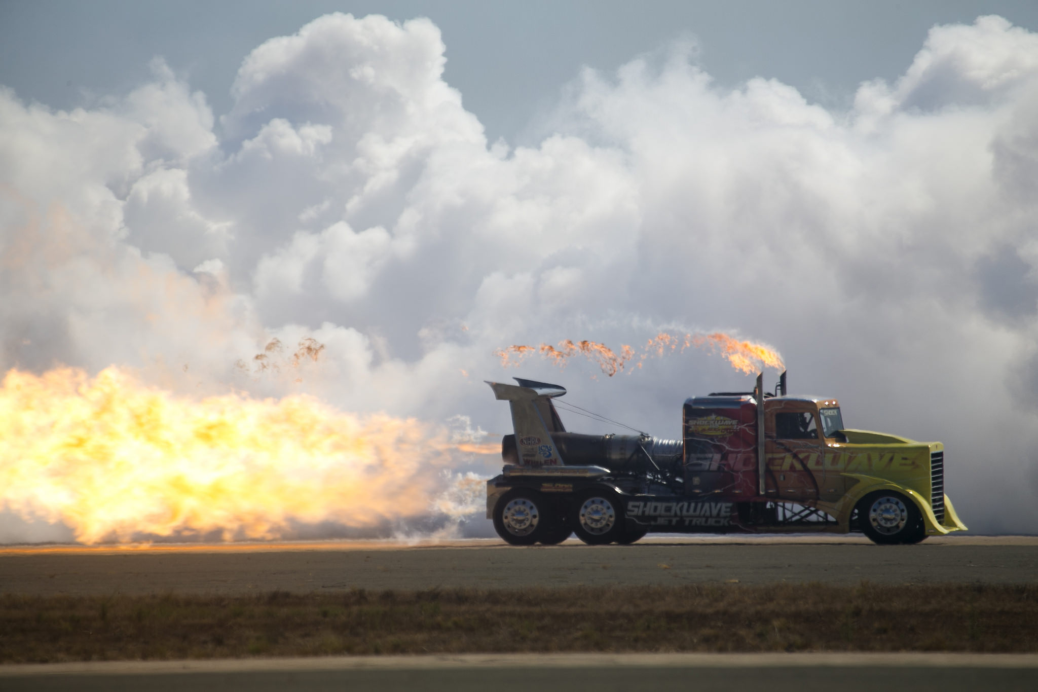 The Shockwave Jet Truck races across the flight line during the 2018 Marine Corps Air Station Miramar Air Show at MCAS Miramar, Calif., Sept. 28, 2018. ( Lance Cpl Raynaldo D. Ramos/Marine Corps)