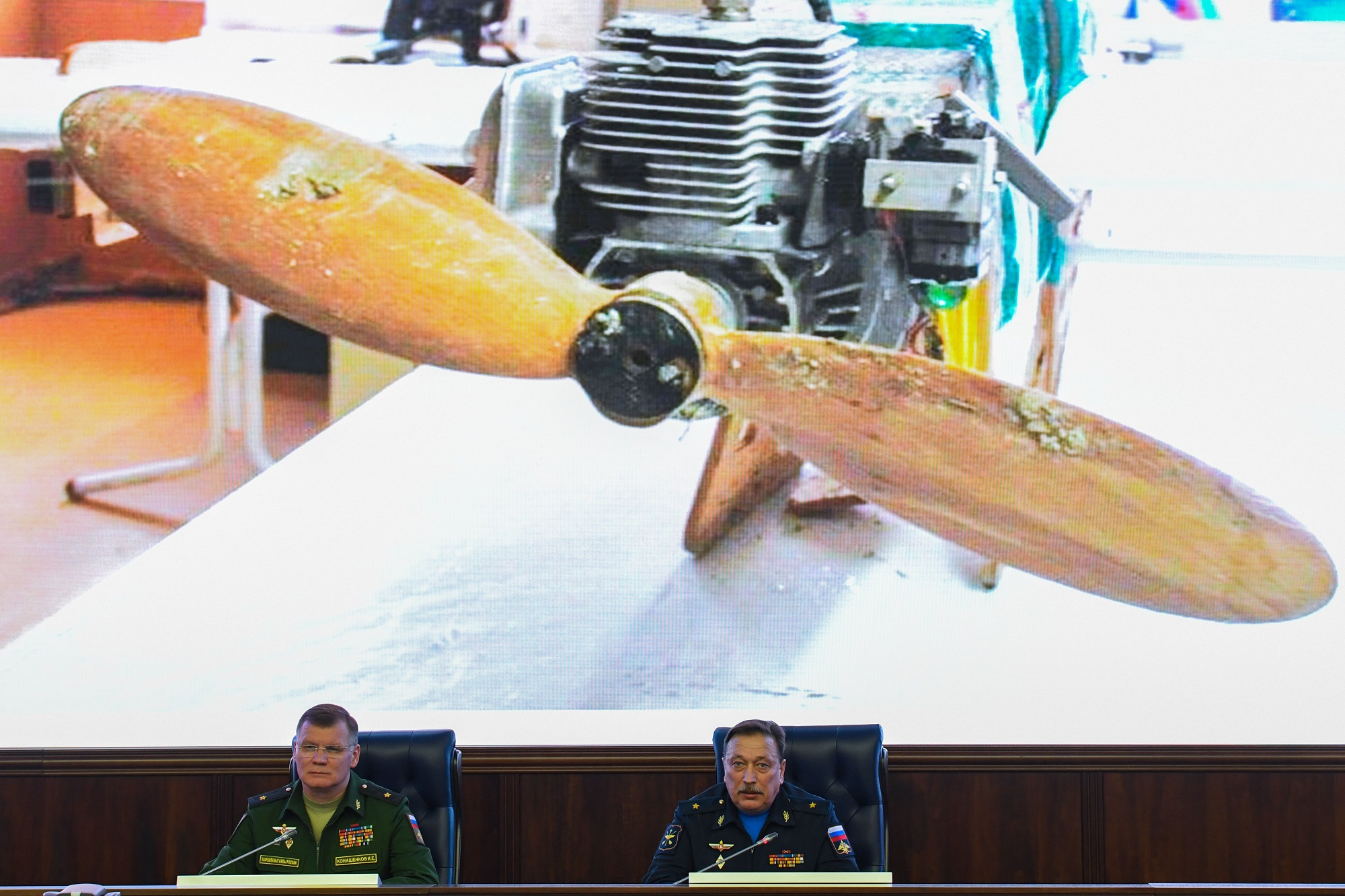 Russia's Defence Ministry spokesman Igor Konashenkov, left, and Maj. Gen. Alexander Novikov, head of the Russian General Staff's department for the development of UAVs, attend a briefing on recent drone attacks on Russia's bases in Syria, in the Russian Defence Ministry headquarters in Moscow on Jan. 11, 2018. (Kirill Kudryavtsev/AFP via Getty Images)