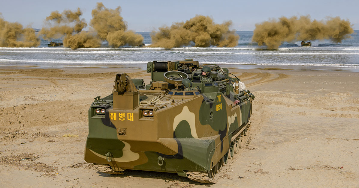 Amphibious armored personnel carriers perform a demonstration during a training camp for civilian volunteers on a beach near the south-eastern city of Pohang on January 14, 2020. - The bi-annual camp is open to civilians and aims to act as an outreach program by the Marines to promote cooperation and further relationships between the military and the public. (Photo by ED JONES/AFP via Getty Images)