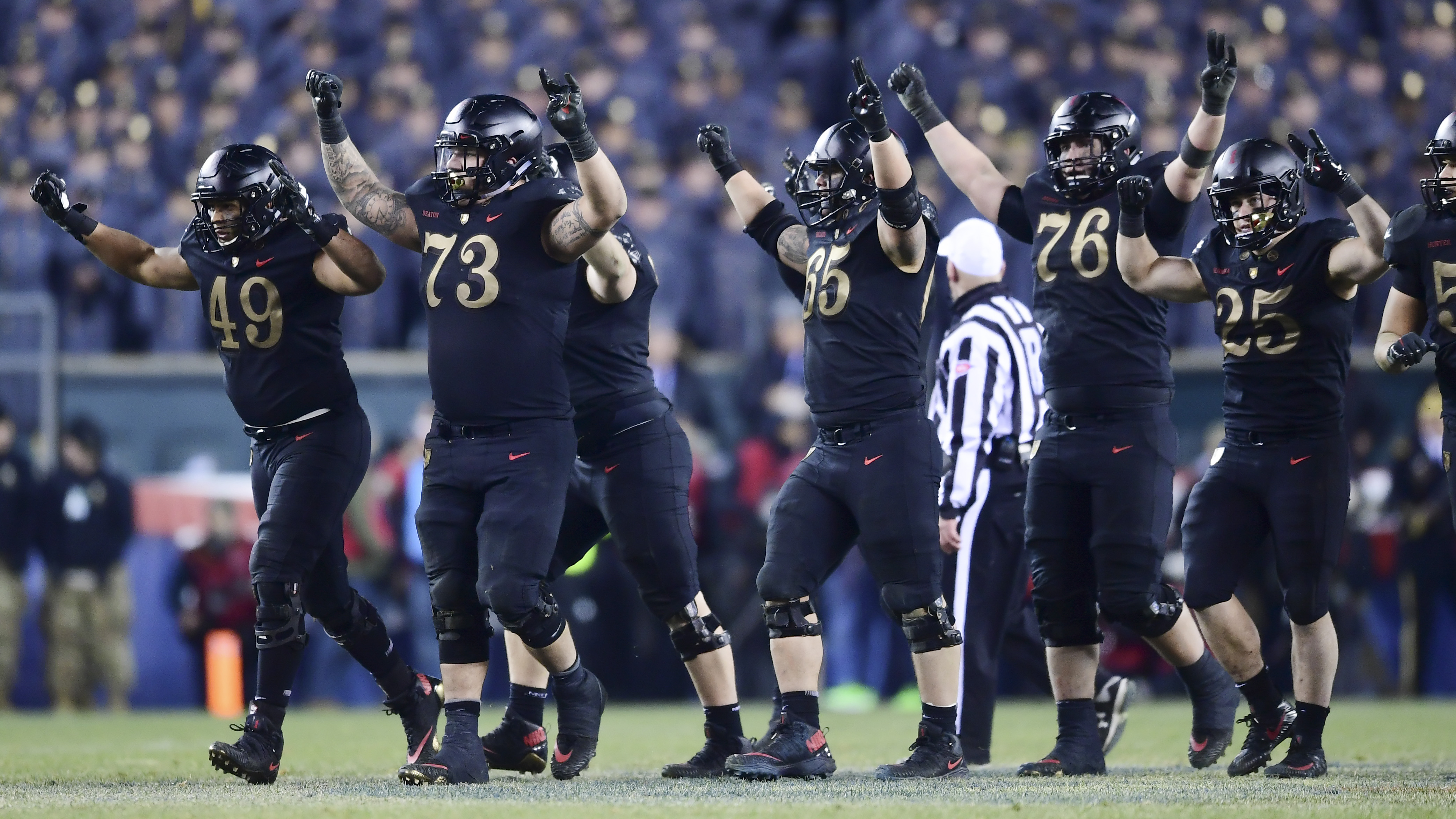 The Army Black Knights celebrate a first down at the end of the third quarter during the game against the Navy Midshipmen at Lincoln Financial Field on December 08, 2018 in Philadelphia, Pennsylvania. (Photo by Sarah Stier/Getty Images)