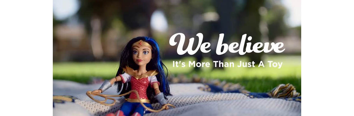 A viral Navy Exchange video shows how a Wonder Woman toy provides comfort to a young son dealing with his mom's absence while she's deployed. (Navy Exchange).