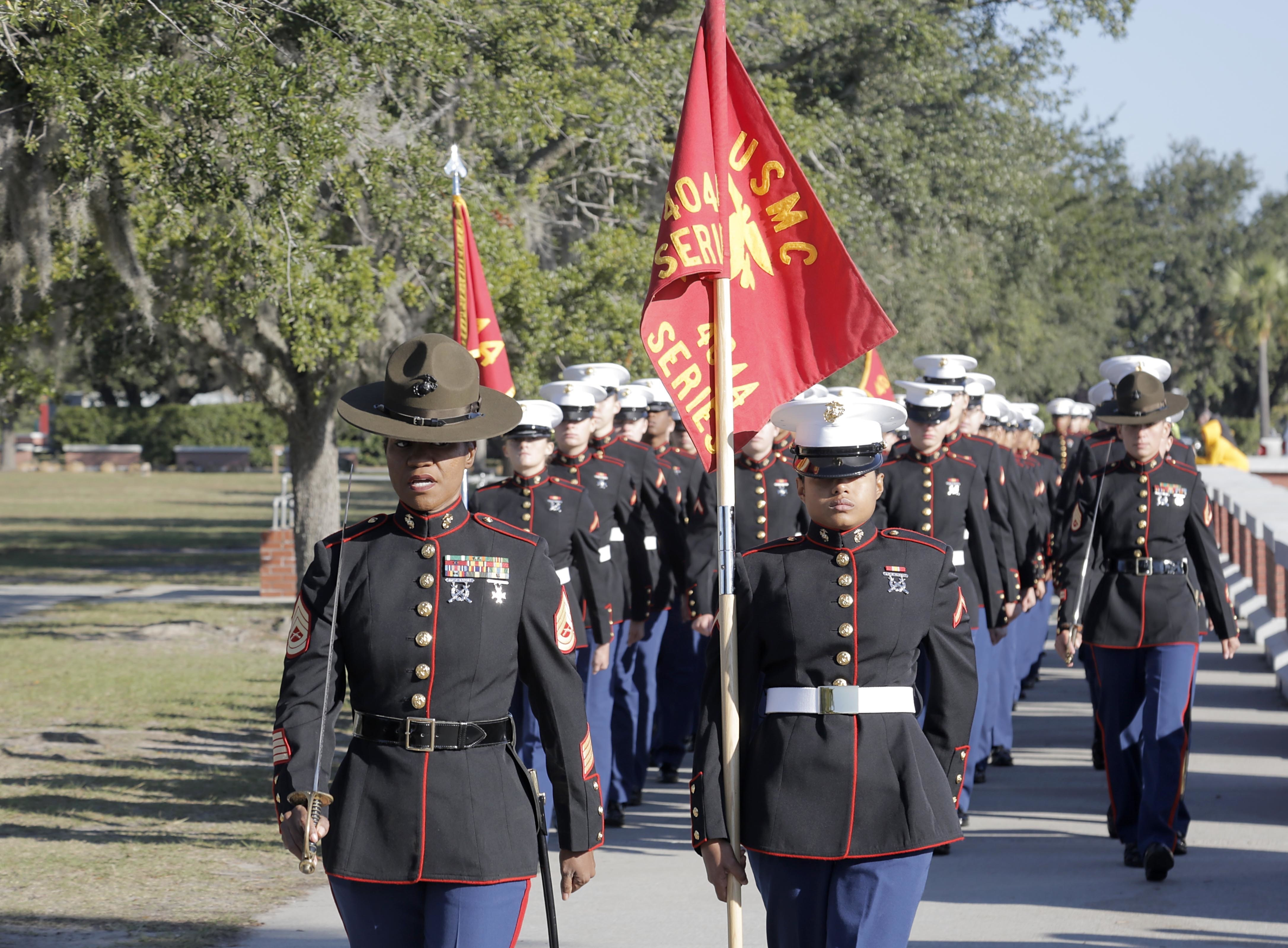 Drill Instructors and Marines with November Company, 4th Recruit Training Battalion, march toward the Peatross Parade Deck before their graduation ceremony Nov. 16 at Marine Corps Recruit Depot Parris Island, South Carolina. (Lance Cpl. Yamil Casarreal/Marine Corps)