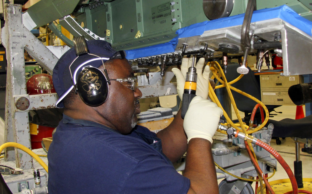 In this Wednesday, April 25, 2018, photo, steam metal assembly riveter Lay Johnson works on an F/A-18 at Boeing's fighter aircraft production line in St. Louis. The Pentagon has the biggest budget in history this year, with $700 billion to spend on defense, including new fighter aircraft. (Ted Shaffrey/AP)