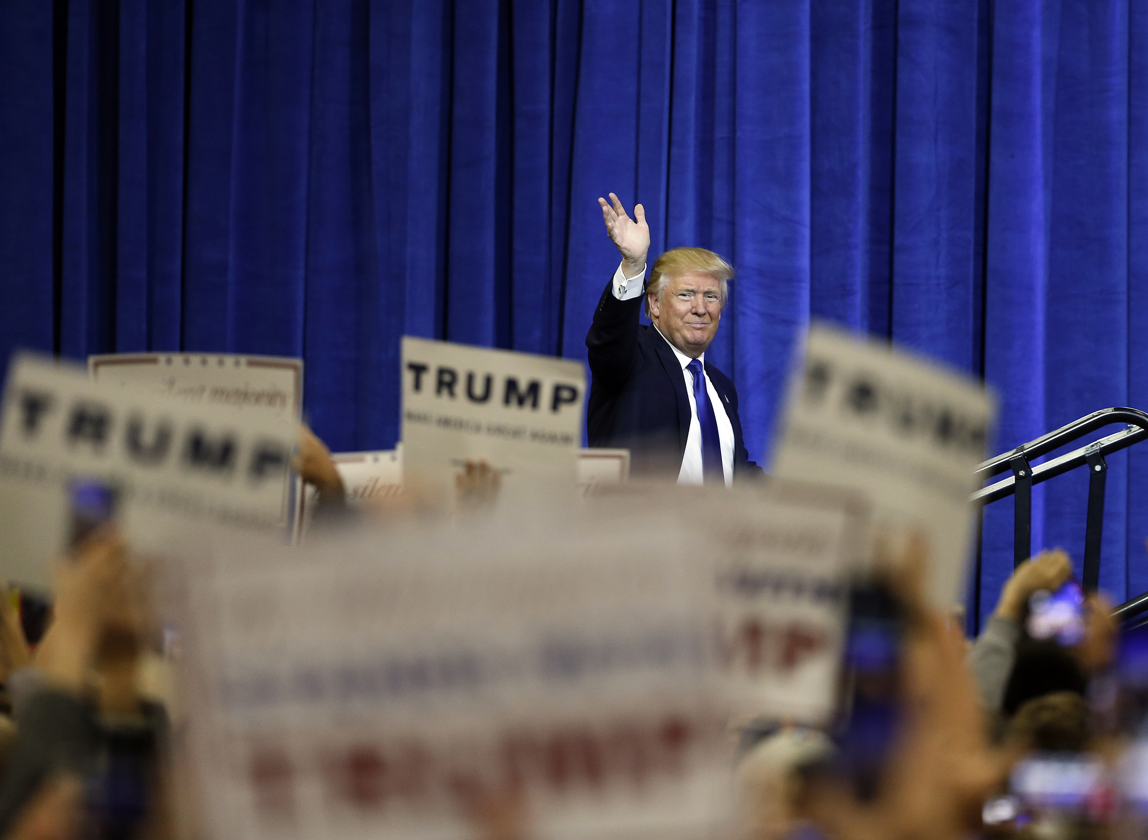 Aspiring Marine booted for harassment of black woman at Trump rally