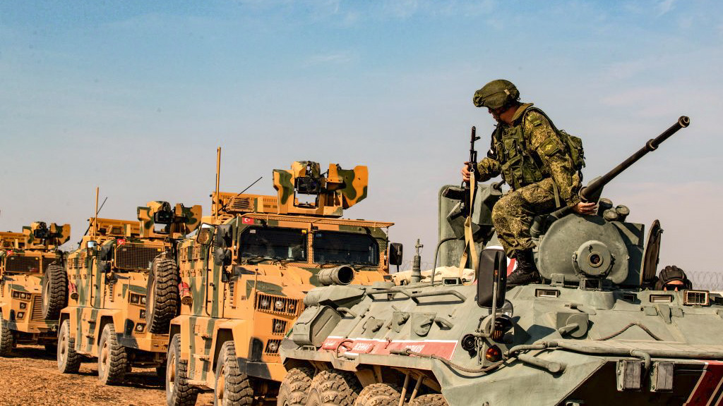 Turkish and Russian military vehicles drive on a joint patrol in the countryside of Darbasiyah town in Syria's northeastern Hasakeh province on the Syrian-Turkish border on November 1, 2019. - Turkey started joint patrols with Russia in northern Syria today to verify whether Kurdish forces have withdrawn from a key border zone in compliance with a deal reached between the two governments. (DELIL SOULEIMAN/AFP via Getty Images)